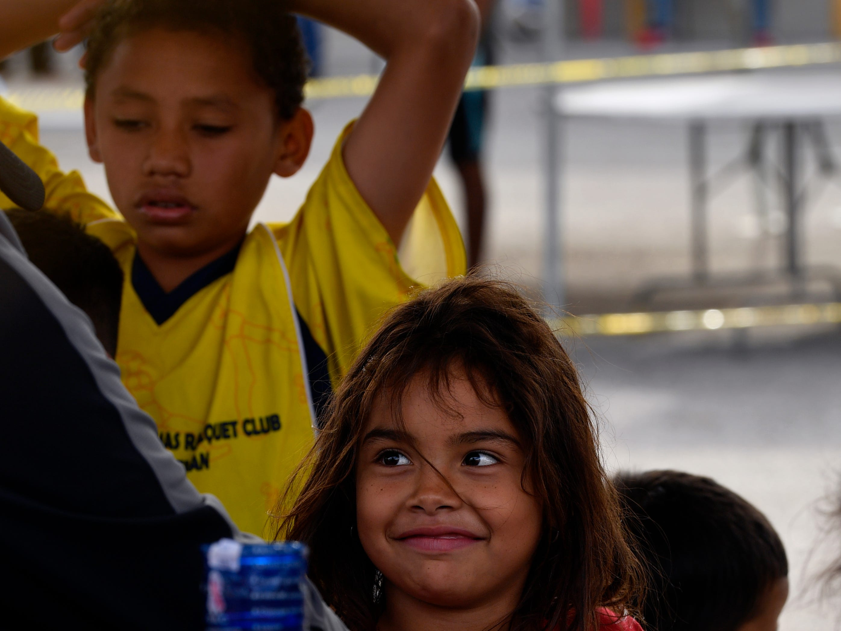 A young girl smiles at an aid worker Thursday Feb. 7, 2019 in the Migrant Hostel in Piedras Negras, Mexico. Dozens of children make up part of the 1,800 Central American migrants who arrived here Monday as a caravan.