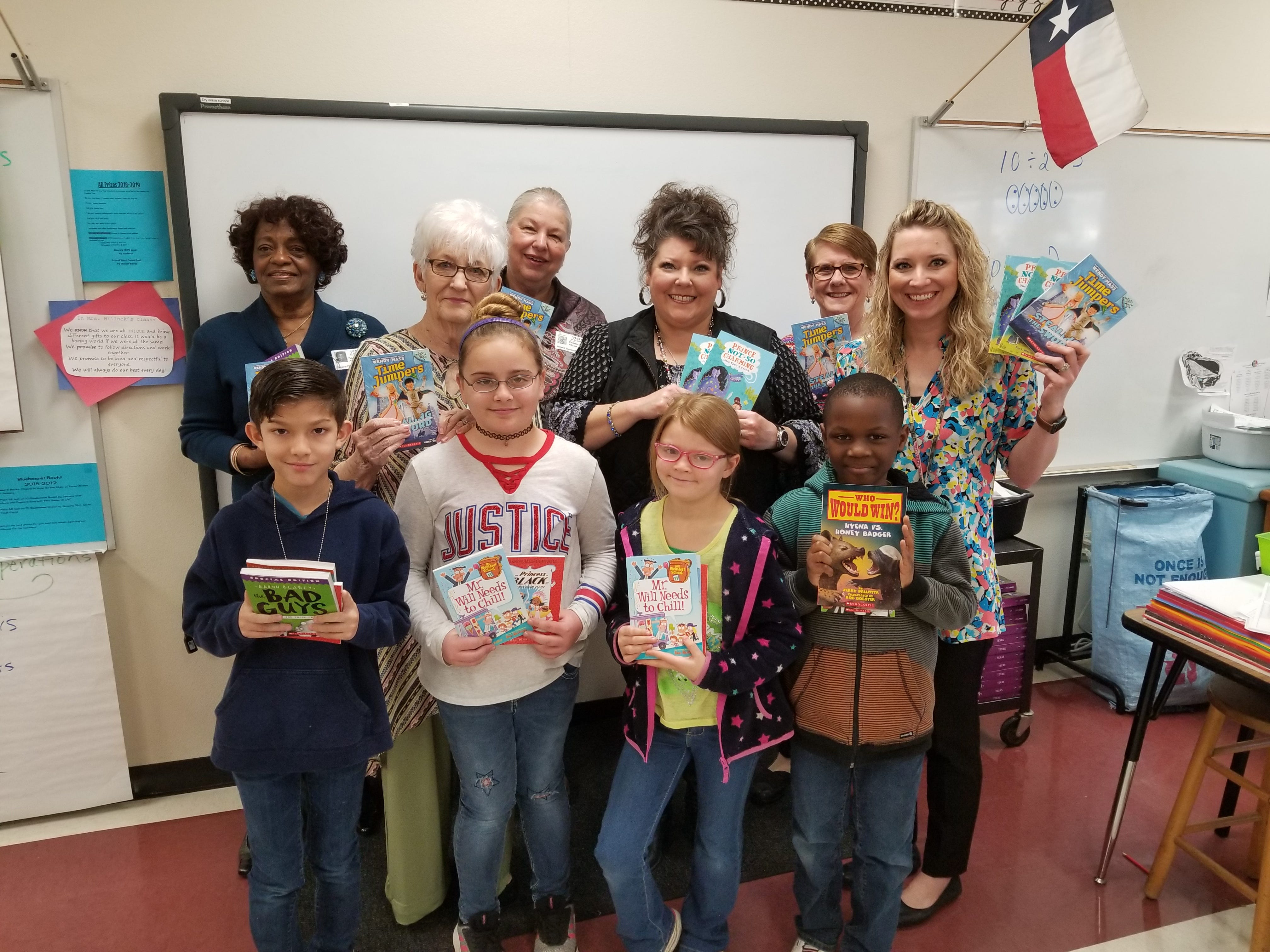 """Members of Altrusa International of Abilene and Bowie Elementary School teachers and students show off some of the books provided by Altrusa's """"Read Every Day"""" grant. Back row, from left: Altrusans Dorthy Drones, Christie Beermann and Gloria Skinner. Middle row: Altrusa president Jo Ann Weinkauf and teachers Michelle Hillock and Jessica Carroll."""