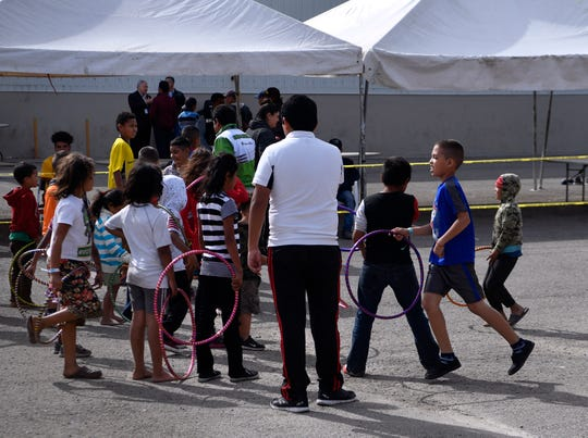 Children play a game with hoops Thursday Feb. 7, 2019 at the Migrant Hostel in Piedras Negras, Mexico. Located across the Rio Grande from Eagle Pass, Texas, the former factory has been converted into a holding area for the 1,800 Central American young adults and families with children who arrived here Monday.