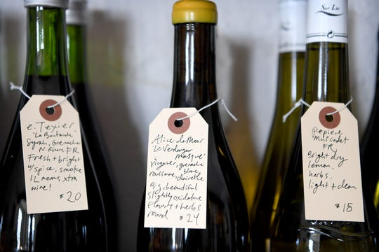 "Handwritten labels describe each of the wines for sale at Crocodile Wine downtown. The new shop sells all ""natural"" wines meaning the grapes are grown sustainably with no pesticides and with indigenous yeast."