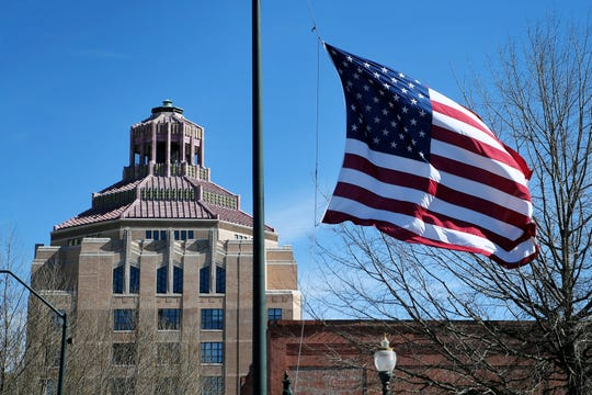 The Asheville Fire departments throughout the city flew their flags at half-staff Friday, Feb. 8, 2019 in honor of fellow firefighter Karen Shuart, who lost her battle with cancer on the day that would've marked her 25th year of service with the department.