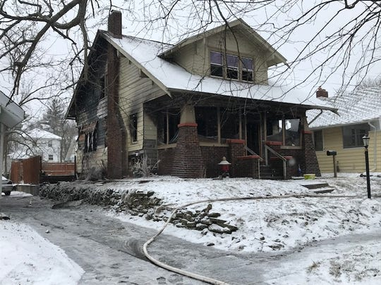 A Friday fire heavily damaged this home at 101 N. Broad St. in Battle Creek.