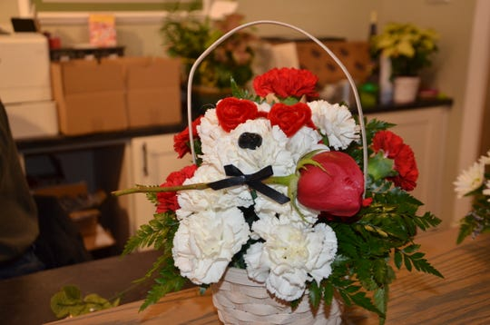 At Plumeria Botanical Boutique, customers can order custom animal arrangements like bears made of carnations for Valentine's Day.