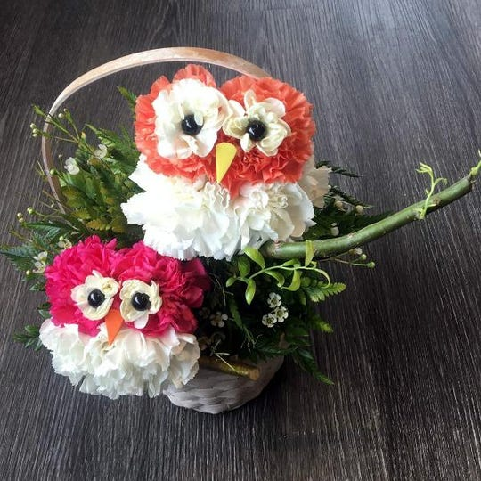 At Plumeria Botanical Boutique, customers can order custom animal arrangements like owls made of carnations.