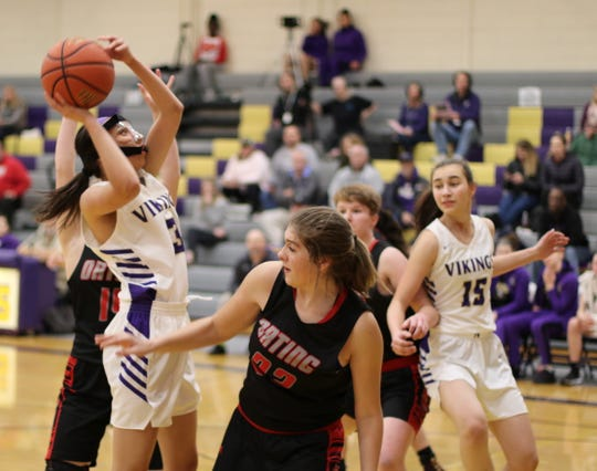 North Kitsap's Shianne Davis-Shearer attempts a shot against Orting.