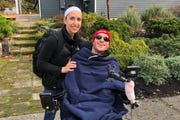 Troy Scott, right, shown with his wife, Dorothy Stam, was paralyzed after being hit by a vehicle while running on Bainbridge Island in June 2018.
