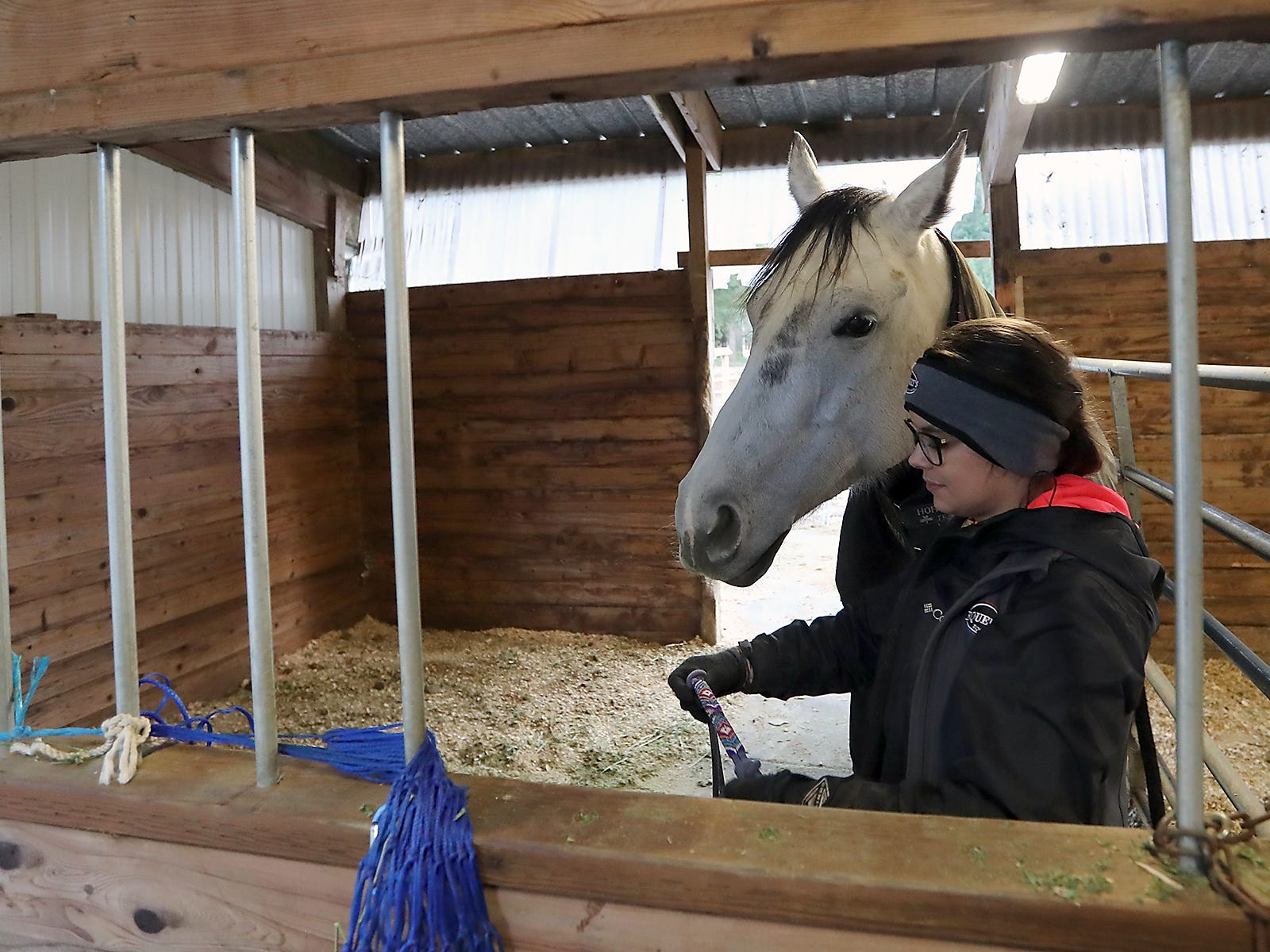 Teresa Morrell readies horse Pearl to be lead out of her stall and to the arena at the ARD Ranch in Silverdale on Thursday, February 7, 2019.