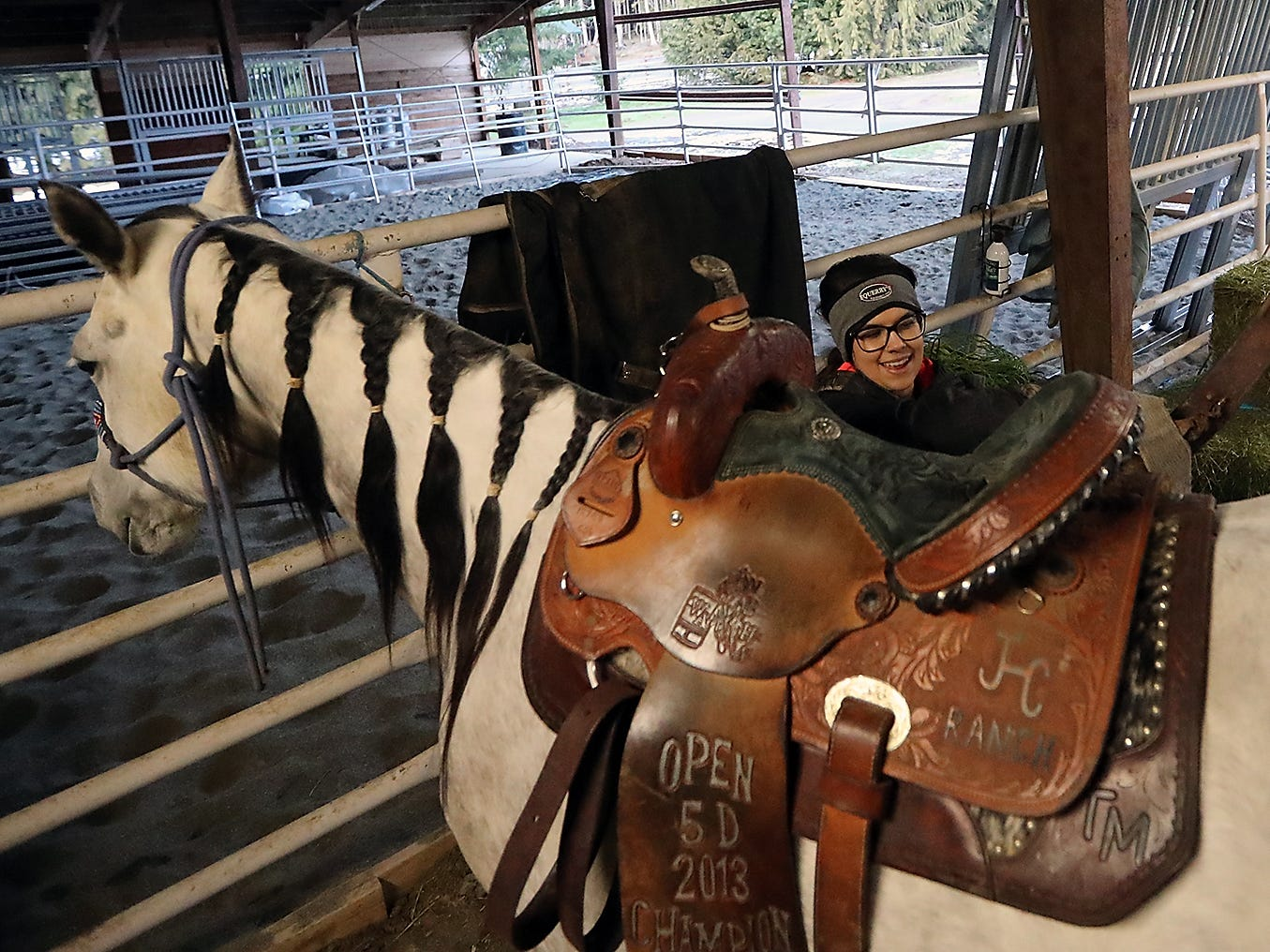 Teresa Morrell saddles Pearl as she gets ready to work with her horses at the ARD Ranch in Silverdale on Thursday, February 7, 2019.