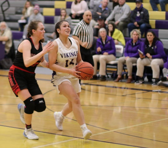 North Kitsap's Noey Barreith goes for a layup during Thursday's district playoff game against Orting.