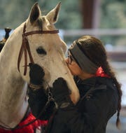Teresa Morrell gives her horse Cali a smooch at the ARD Ranch in Silverdale on Thursday, February 7, 2019.