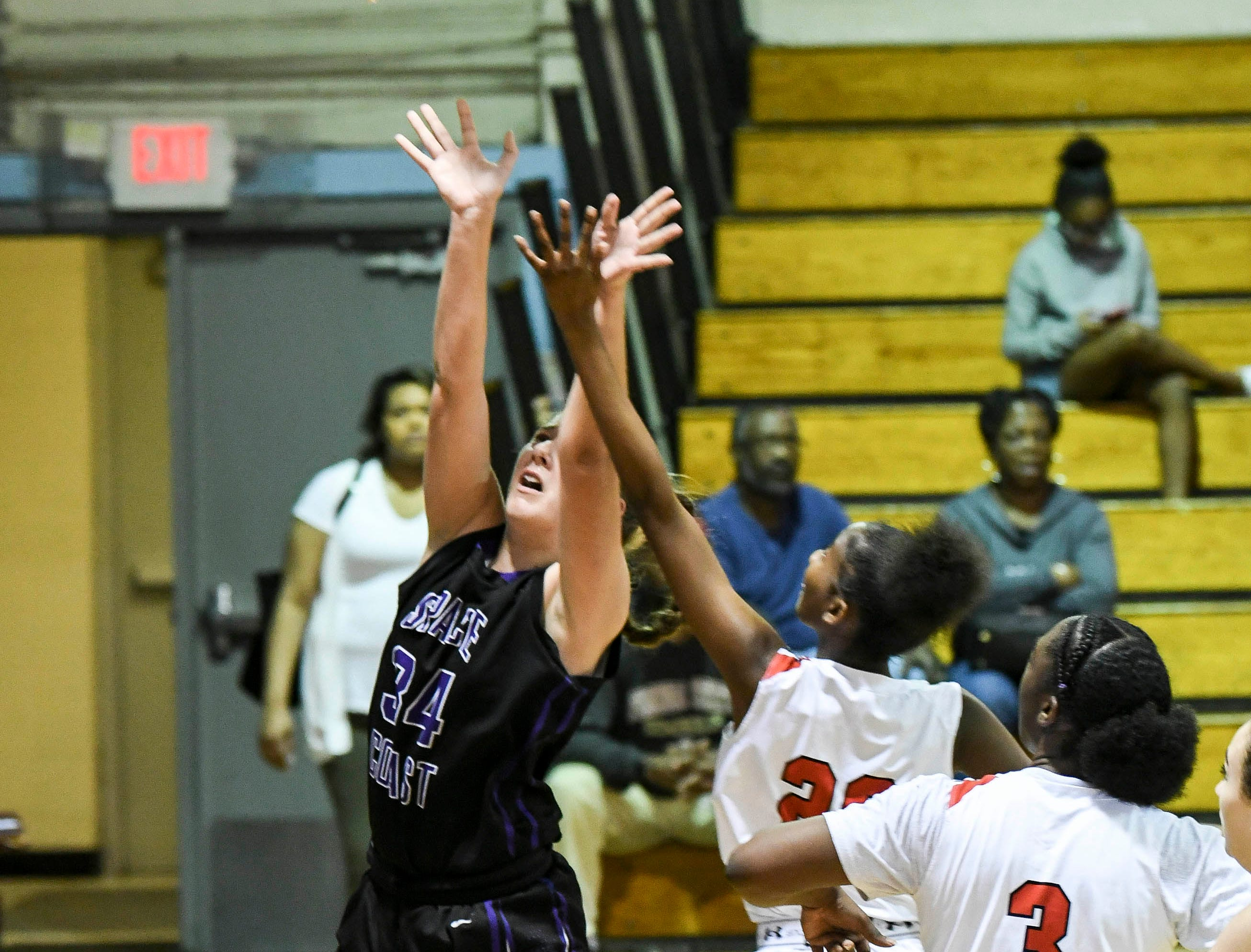 Danelle Marie of Space Coast takes a shot during Thursday's District 14-6A basketball tournament at Rockledge High School.