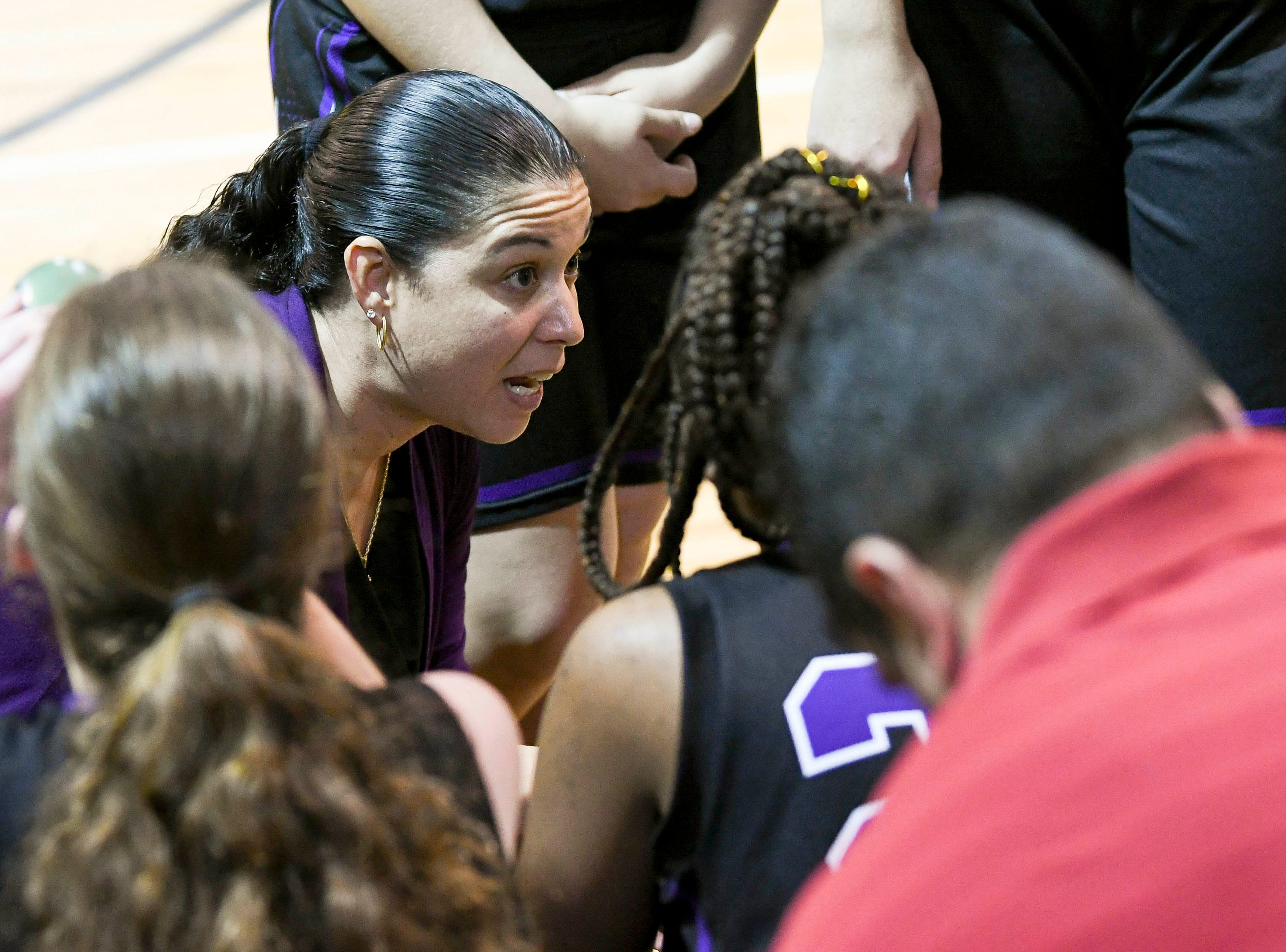 Space Coast girls basketball head coach Vanessa Santiago talks with her players during Thursday's District 14-6A basketball tournament semifinal at Rockledge High School.