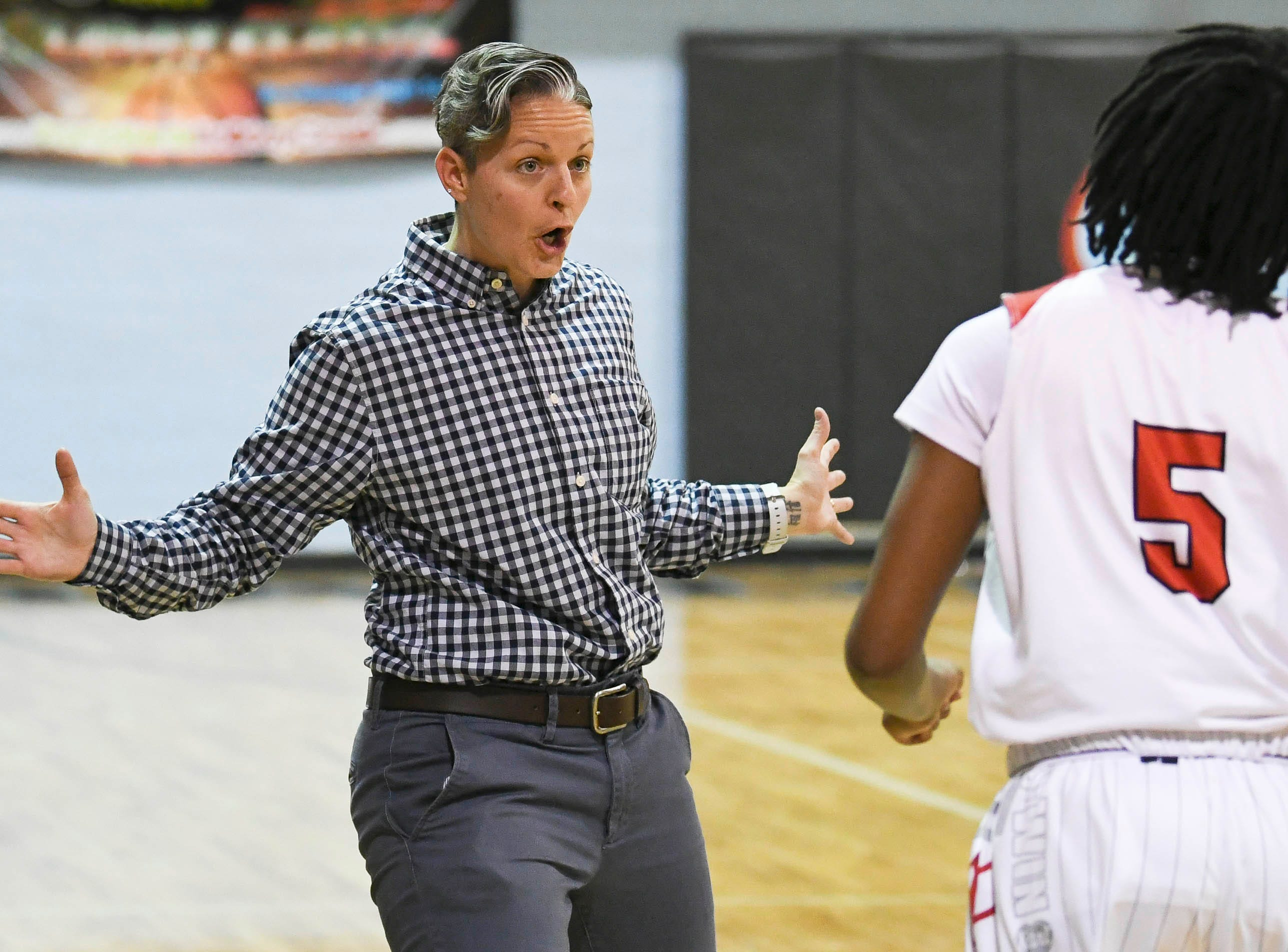 Palm Bay girls basketball head coach Sara Murano talks with her players during Thursday's District 14-6A basketball tournament at Rockledge High School.