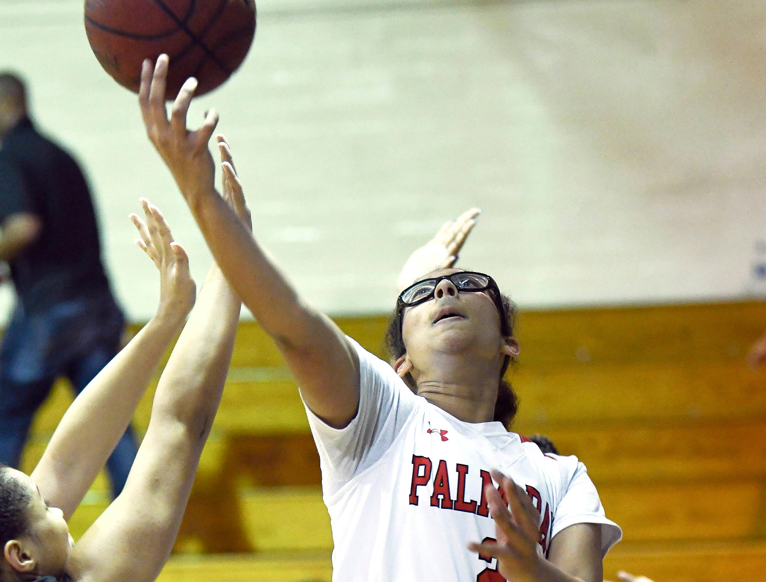 Palm Bay's Mary Penland-Holmes takes a shot during Thursday's District 14-6A basketball tournament at Rockledge High School.