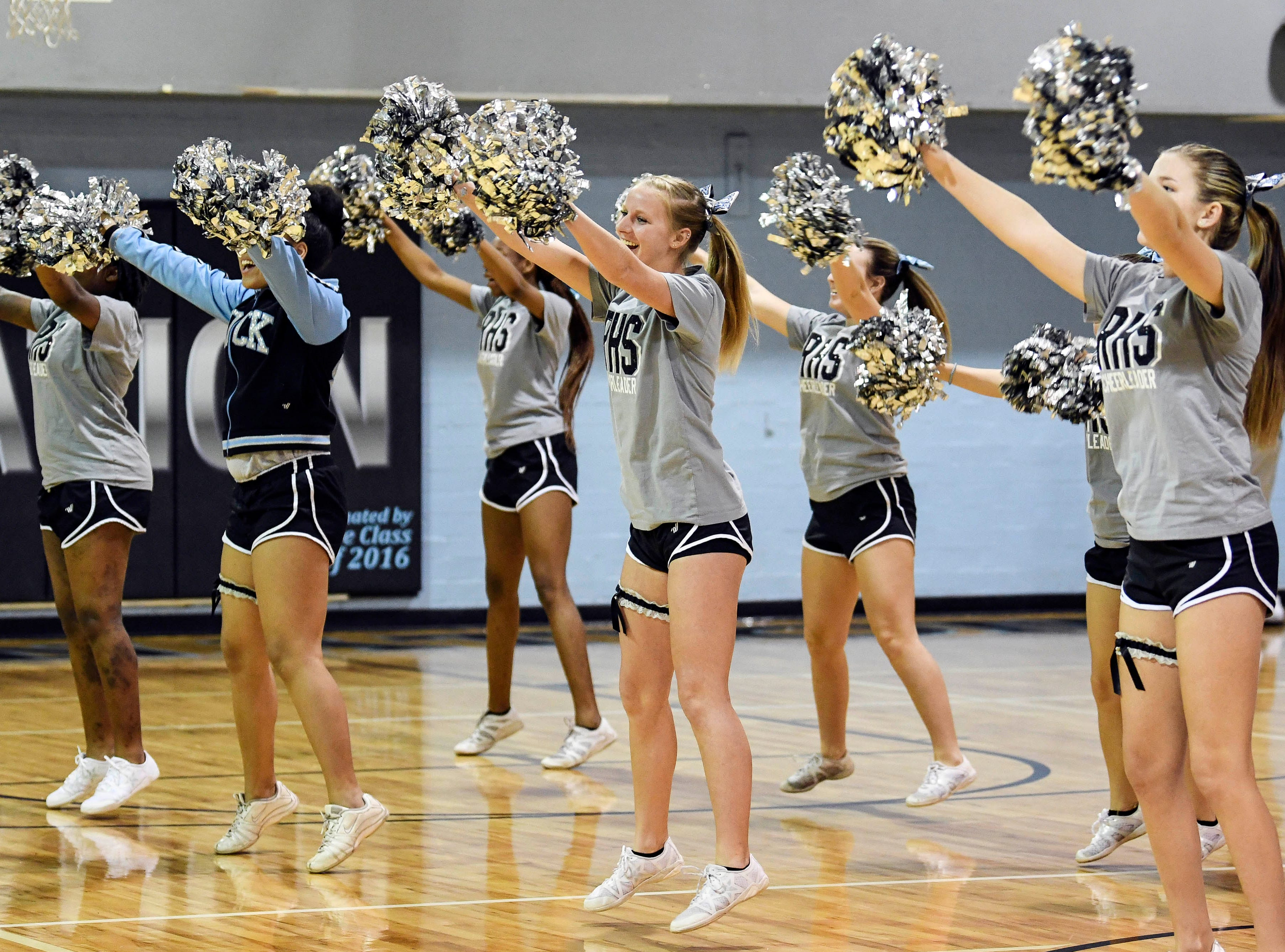 The Rockledge cheerleaders perform during District 14-6A basketball tournament at Rockledge High School.