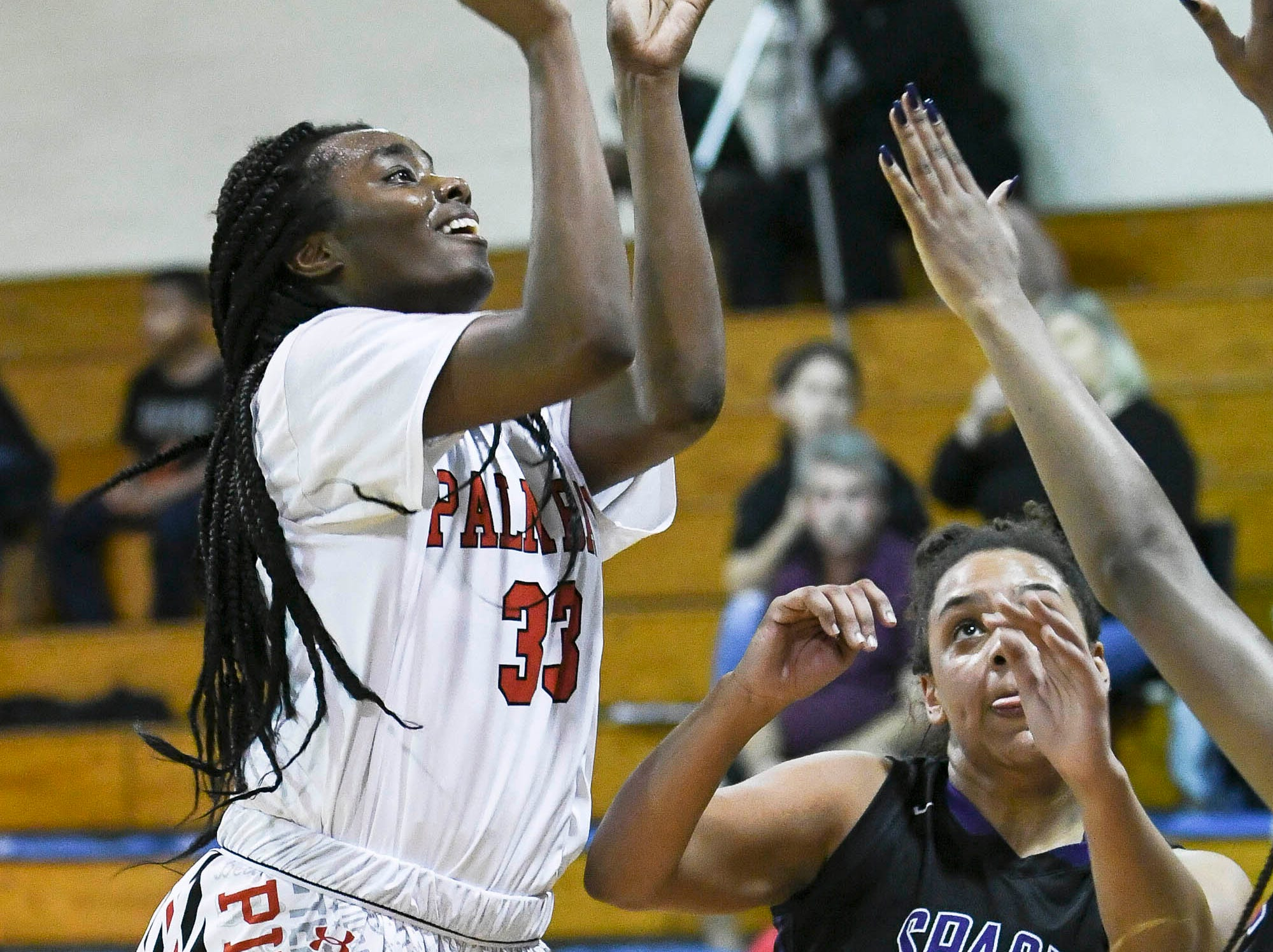 Emani Burks of Palm Bay shoots over Teagan Rothiock of Space Coast during Thursday's District 14-6A basketball tournament at Rockledge High School.