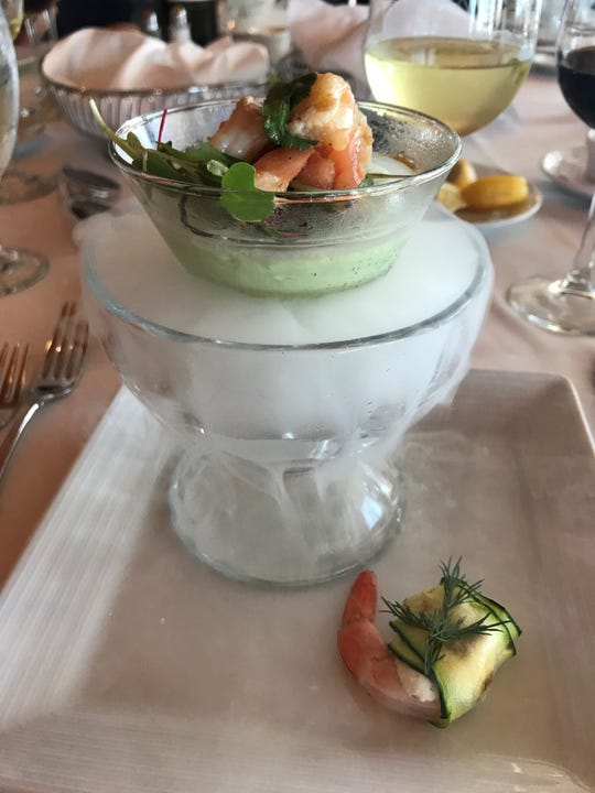 Eau Gallie Yacht Club executive chef Mark E. Adams created this chilled cucumber and avocado soup with shrimp and tomato concasse on a bed of dry ice.