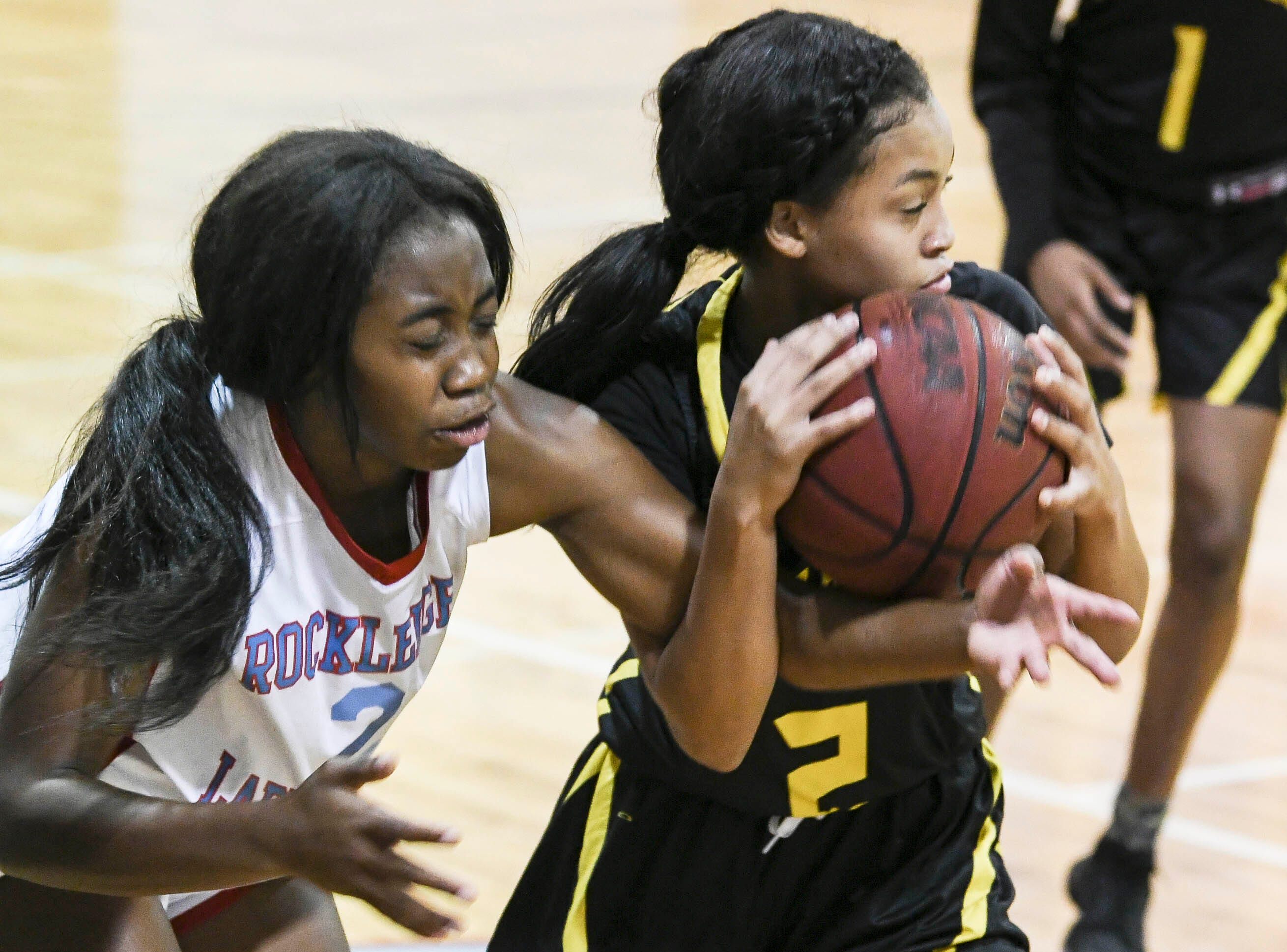 Jyda Christian of Rockledge and Shakira Fernandez of Merritt Island fight for possession of  the ball during Thursday's District 14-6A basketball tournament at Rockledge High School.