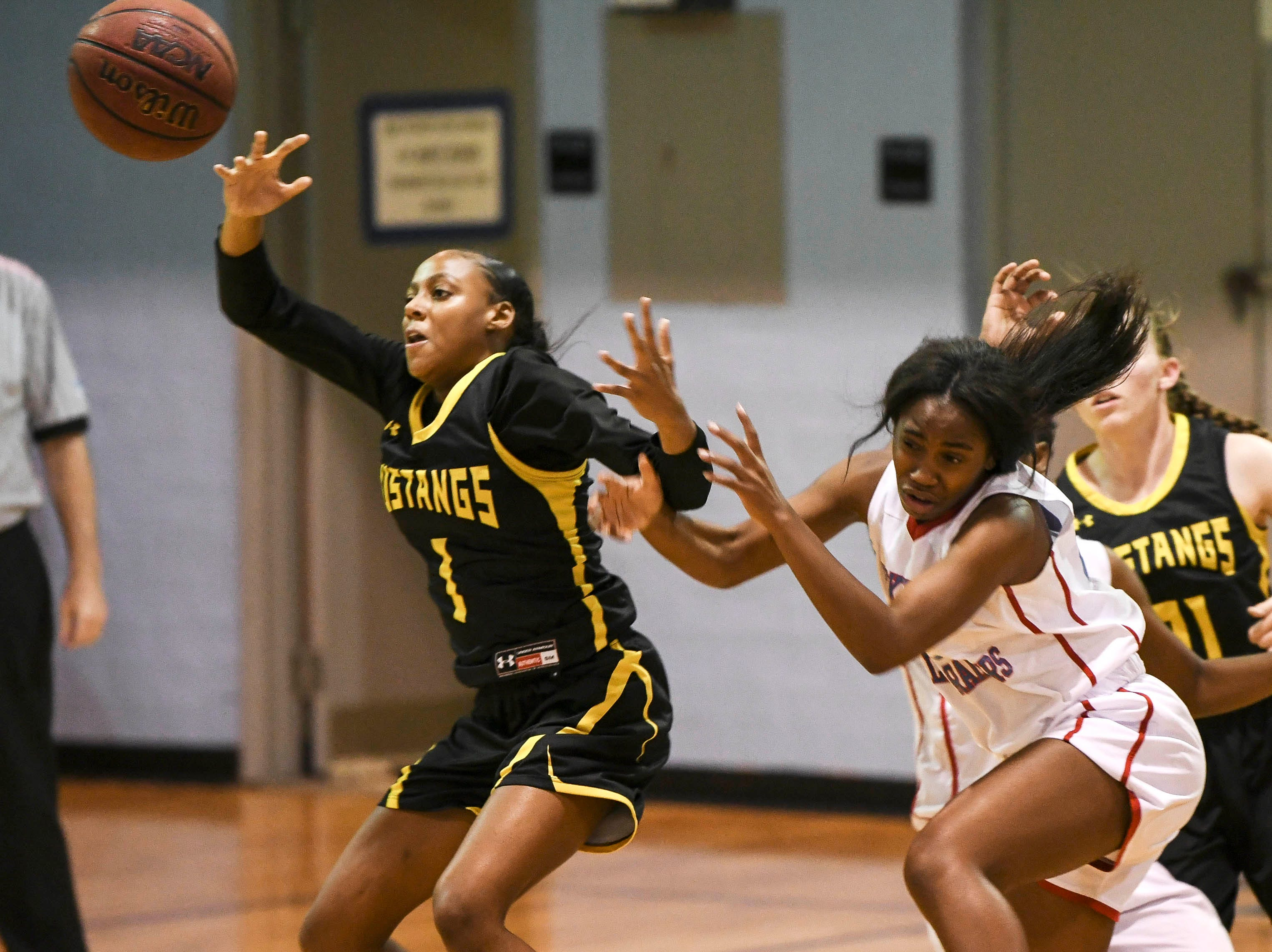 Tiana Devoe of Merritt Island collides with District 14-6A basketball tournament at Rockledge High School.