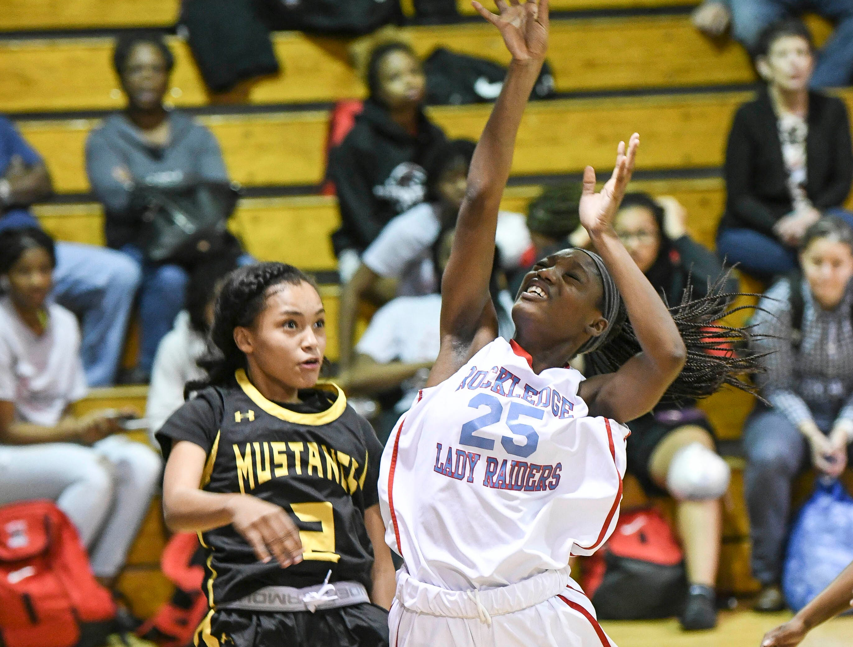 A'vonia Oquendo-Waters of Rockledge shoots over Merritt Island defender Shakira Fernandez during Thursday's District 14-6A basketball tournament at Rockledge High School.
