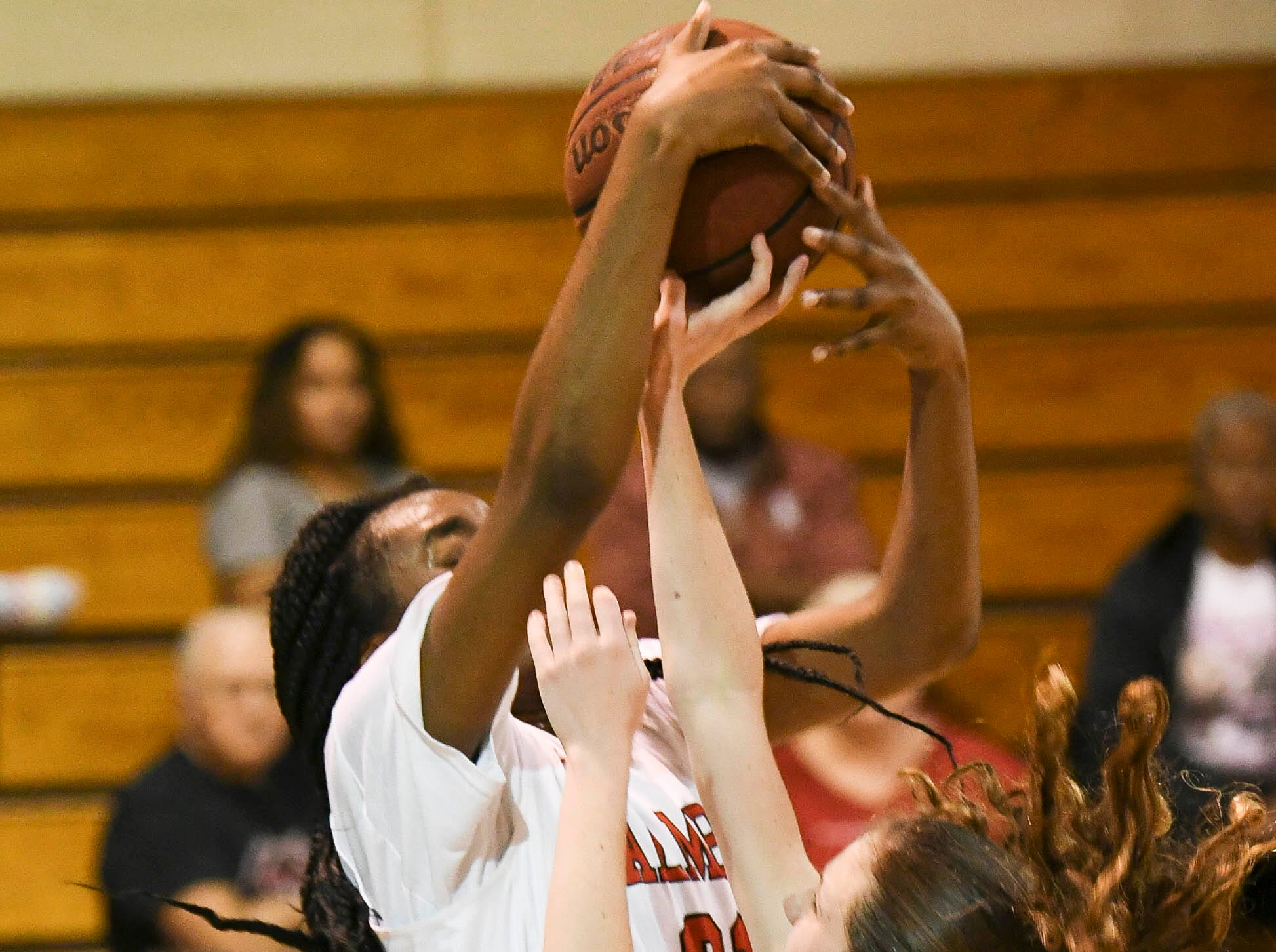 Ashley Cathon of Space Coast has her shot blocked by Palm Bay's Emani Burks during Thursday's District 14-6A basketball tournament semifinal at Rockledge High School.