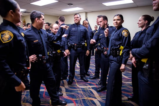 77th Corpus Christi Police Department Police Academy Graduates joke around before their graduation ceremony begins at Selena Auditorium on Friday, February, 8, 2019.