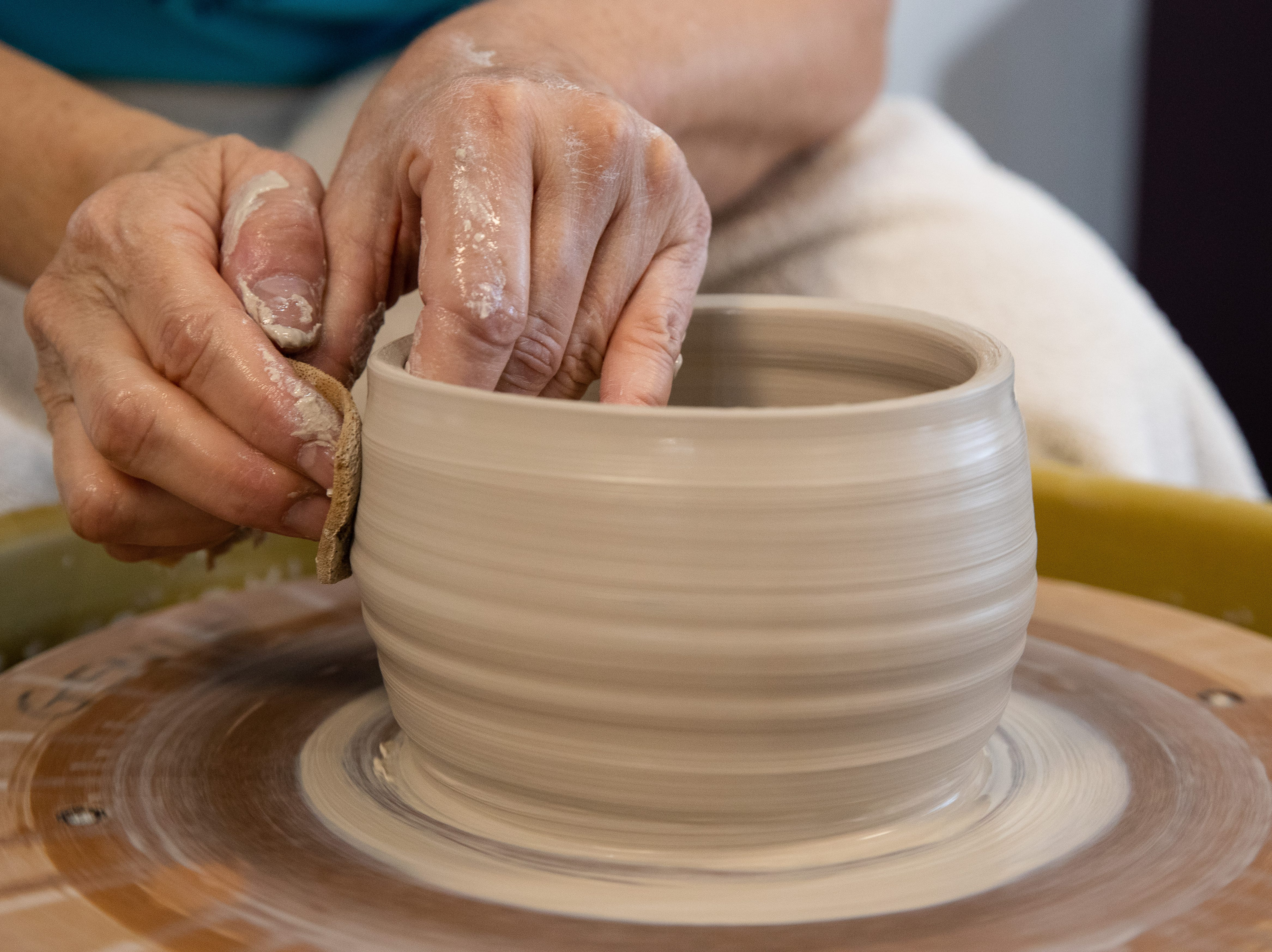 Genie Mysorski works with clay at the Wind Way Gallery at 203 South Austin Street in Rockport.