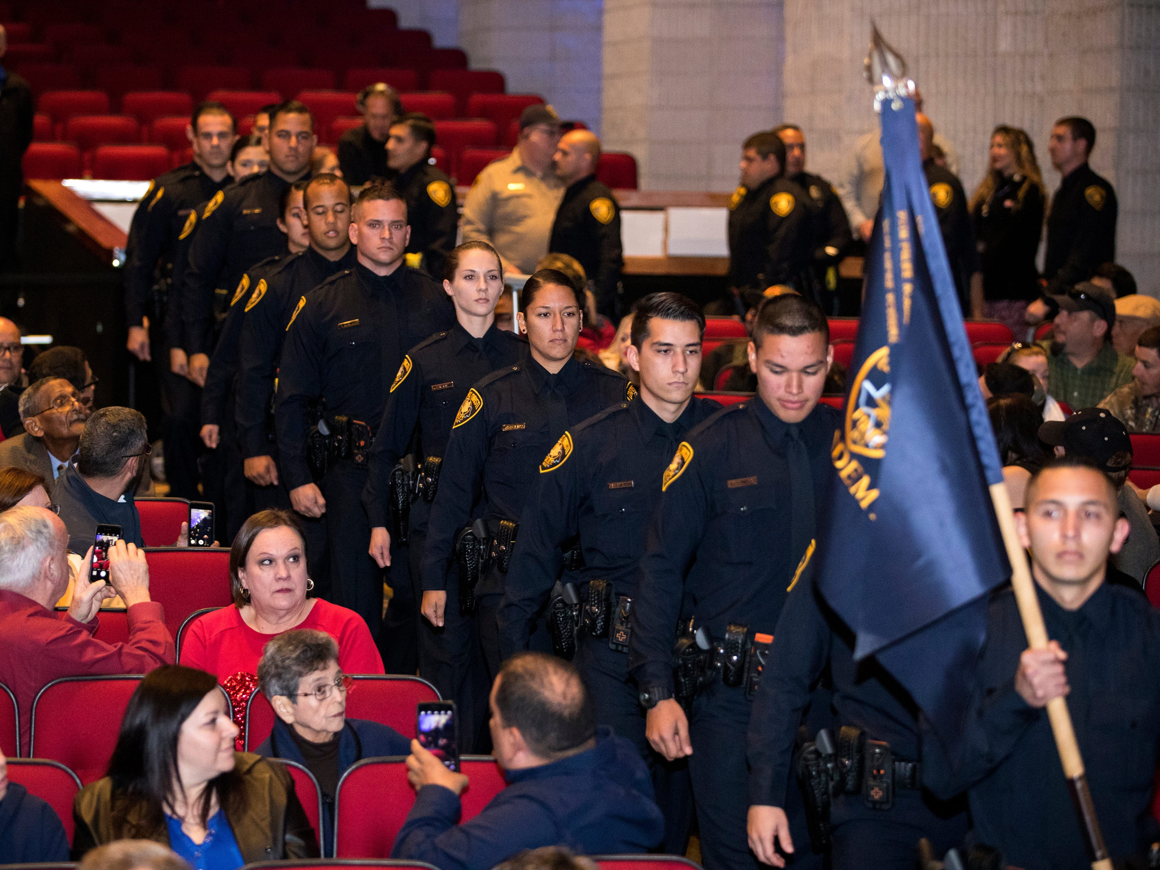 The 77th Corpus Christi Police Department Police Academy Graduates enter the Selena Auditorium for graduation on Friday, February, 8, 2019.