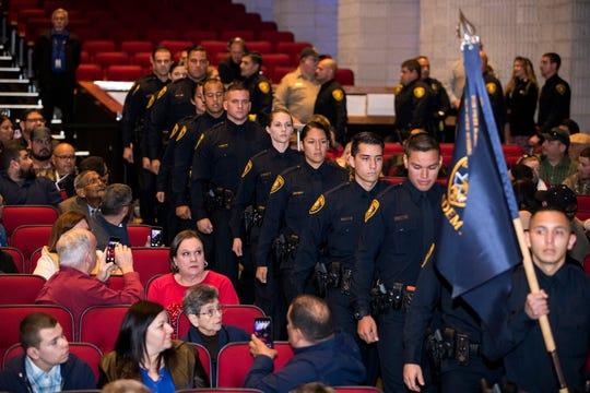 The 77th Corpus Christi Police Department Police Academy Graduates enter the Selena Auditorium for graduation on Friday, February, 8, 2019.