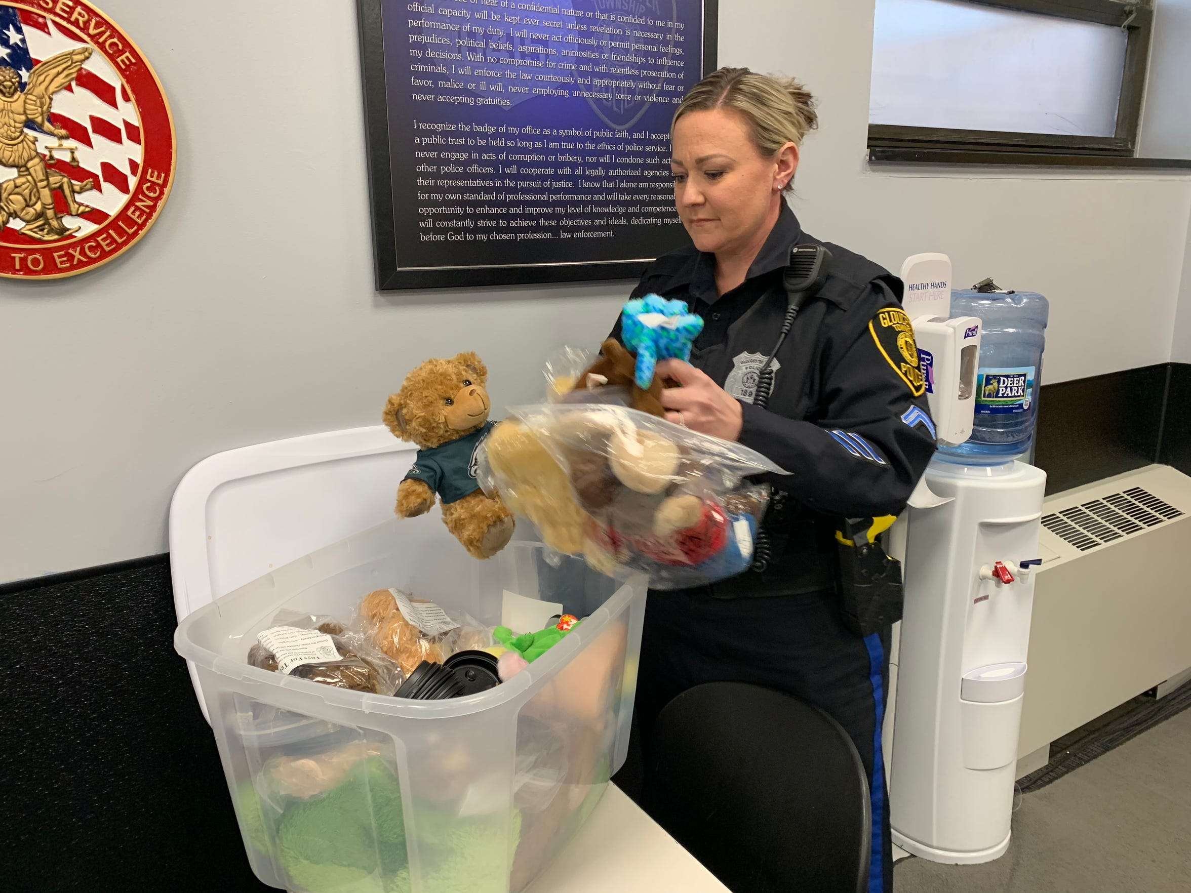 Gloucester Township Police Ptl. Jen McLaughlin digs through a bin of stuffed animals donated to the department. The toys are used as tools for children officers encounter in high-stress situations to calm tension and put kids facing trauma at ease.