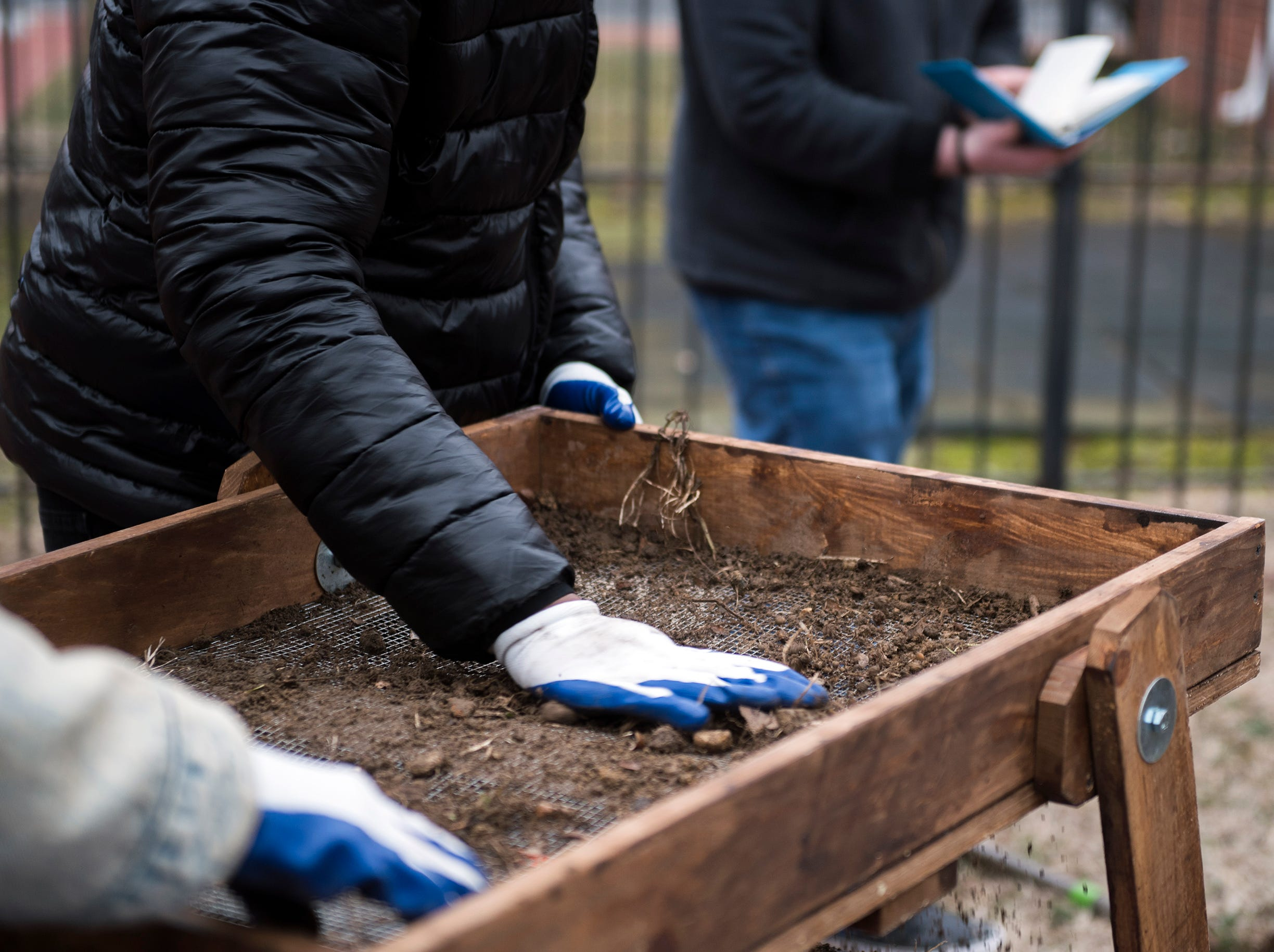 Students sift through soil Thursday, Feb. 7, 2019 behind the Rutgers-Camden Office of Civic Engagement in Camden, N.J.
