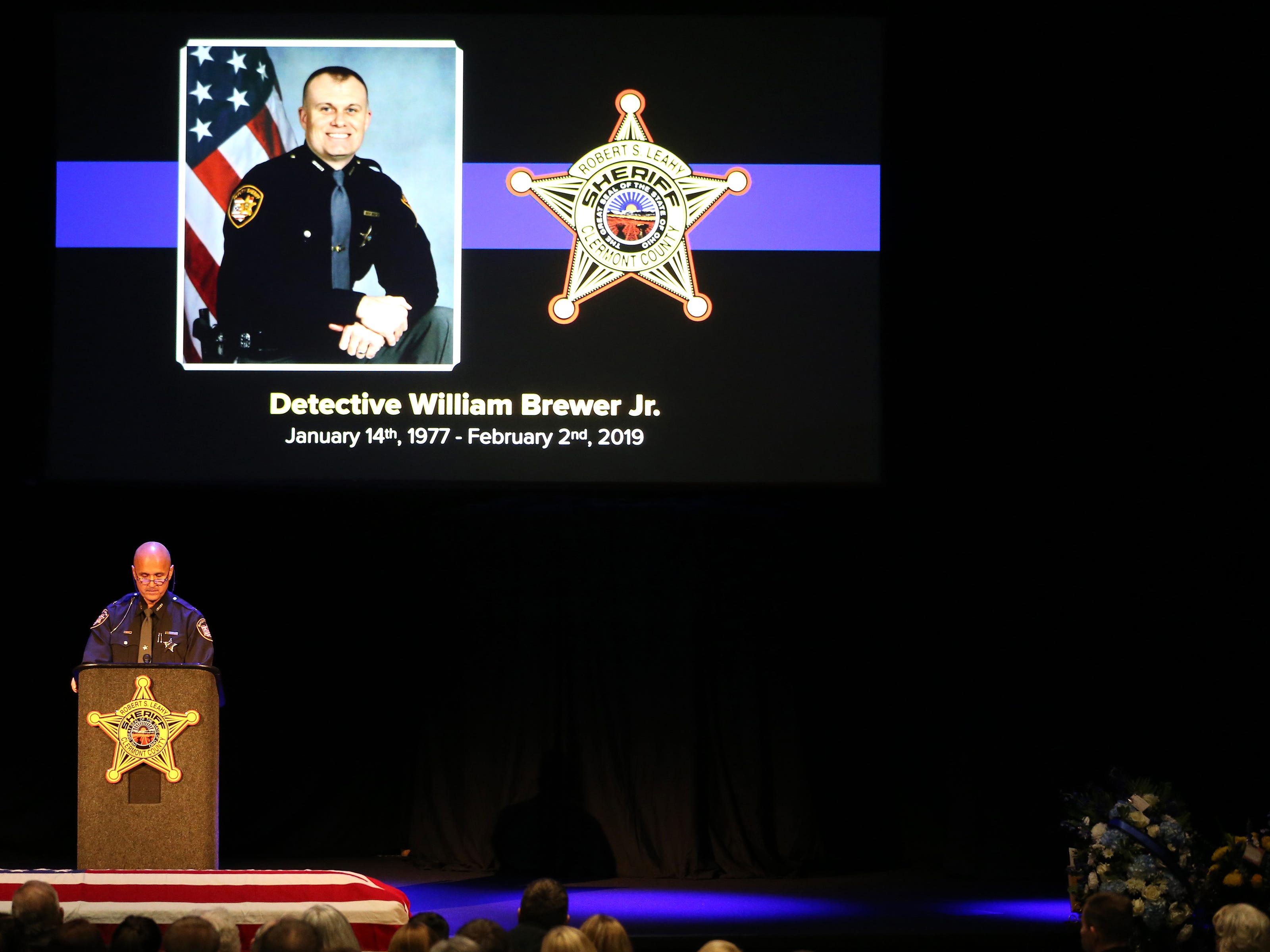 Clermont County Sheriff Robert Leahy delivers remarks during funeral services for Clermont County Sheriff's Detective William Lee Brewer Jr., Friday, Feb. 8, 2019, at Mount Carmel Christian Church in Union Township, Ohio. Brewer, a 20-year veteran of the Clermont County Sheriff's Office, died in the line of duty. He was shot Feb. 2 during a standoff. Brewer, 42, of Pierce Township, is survived by his wife, Jamie, and a 5-year-old son, Braxton. (Kareem Elgazzar/The Cincinnati Enquirer)