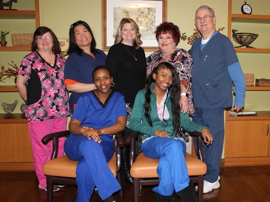 Back row: Roberta Padgett, Meiling Barnes, Tonia Burton, Kathy Schulze and Mike Lasko. Seated: Fatima Sow and Mariah Lewis.