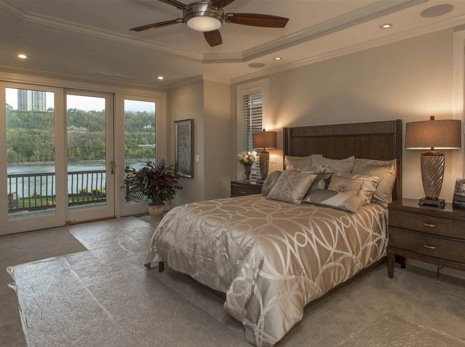 The first-floor master suite features a walkout to a patio overlooking the Ohio River.