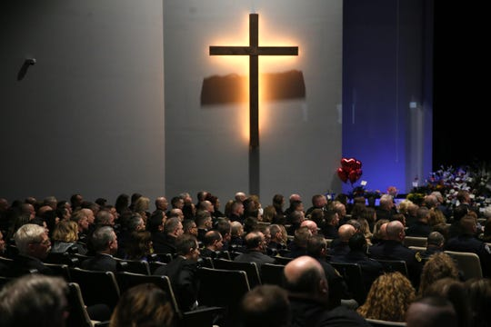 People pay their respects during funeral services for Clermont County Sheriff's Detective William Lee Brewer Jr., Friday, Feb. 8, 2019, at Mount Carmel Christian Church in Union Township, Ohio. Brewer, a 20-year veteran of the Clermont County Sheriff's Office, died in the line of duty. He was shot Feb. 2 during a standoff. Brewer, 42, of Pierce Township, is survived by his wife, Jamie, and a 5-year-old son, Braxton. (Kareem Elgazzar/The Cincinnati Enquirer)