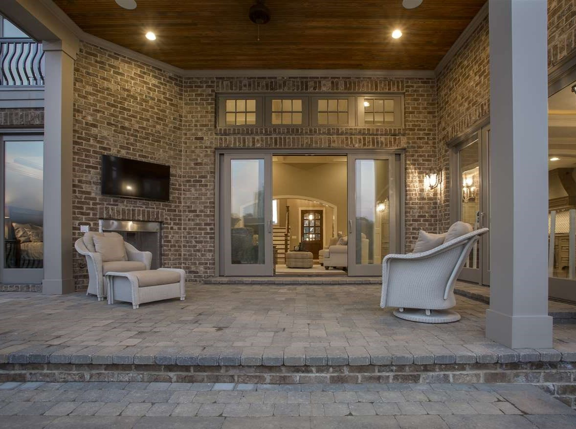 The $40,000 cobblestone patio comes complete with a fireplace and flat-screen TV.