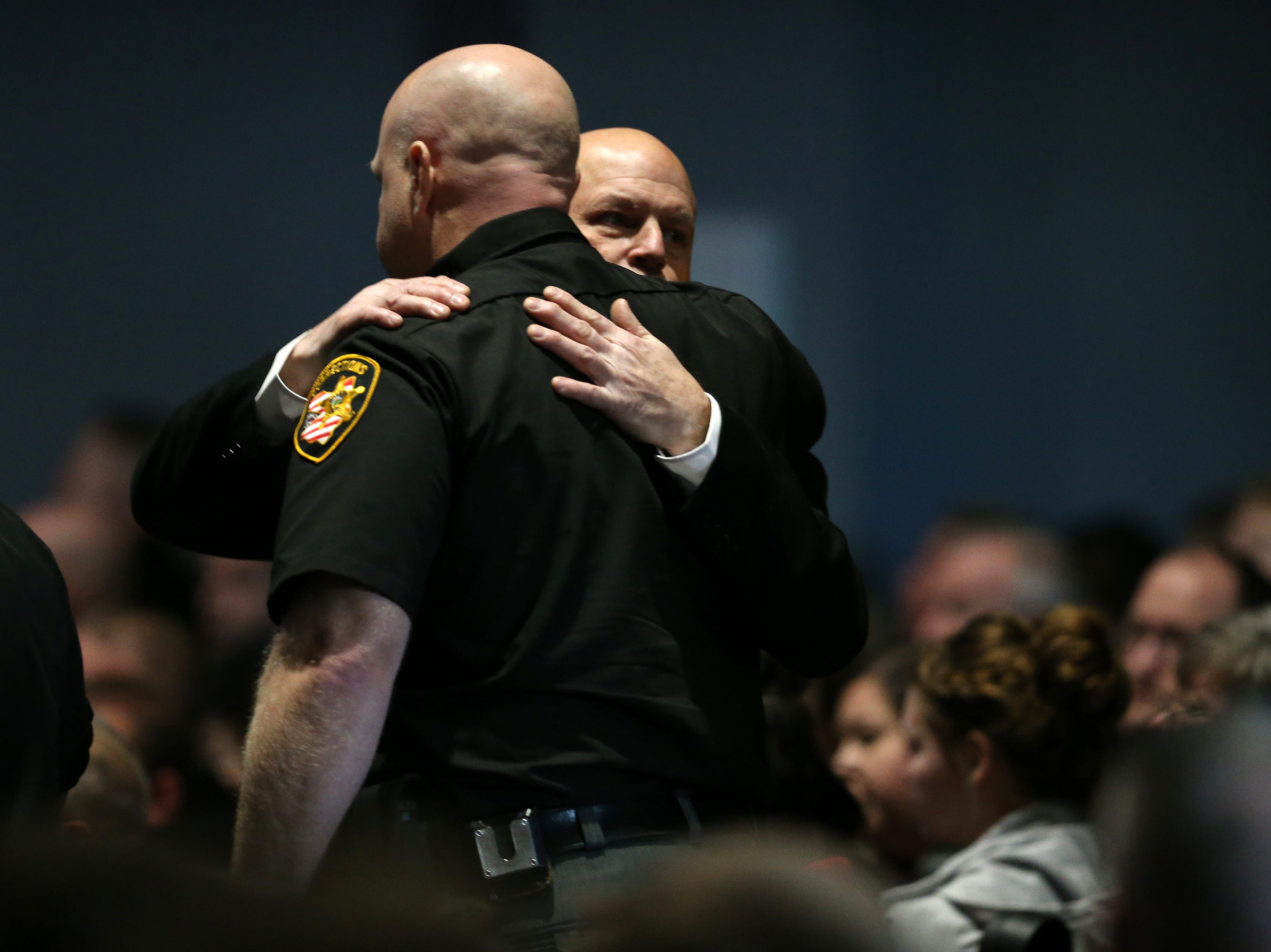 Members of the Clermont County Sheriff's Office embrace as the enter to pay their respects during funeral services for Clermont County Sheriff's Detective William Lee Brewer Jr., Friday, Feb. 8, 2019, at Mount Carmel Christian Church in Union Township, Ohio. Brewer, a 20-year veteran of the Clermont County Sheriff's Office, died in the line of duty. He was shot Feb. 2 during a standoff.