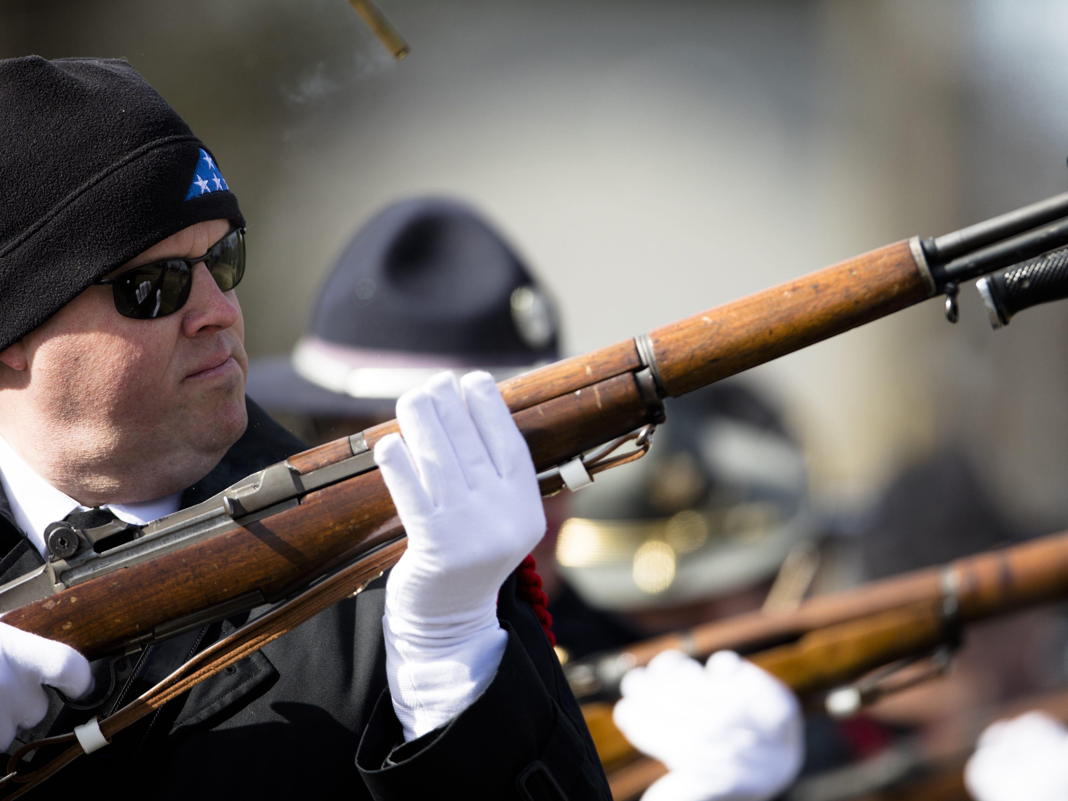 The honor guard team practices firing in unison before the burial service of Detective Bill Brewer, a 20-year veteran of the Clermont County Sheriff's Office, on Friday, Feb. 8, 2019, at Pierce Township Cemetery in Cincinnati. Brewer, 42, of Pierce Township, died in the line of duty. He was shot Feb. 2 during a standoff. Deputy Brewer is survived by a wife and 5-year-old son.
