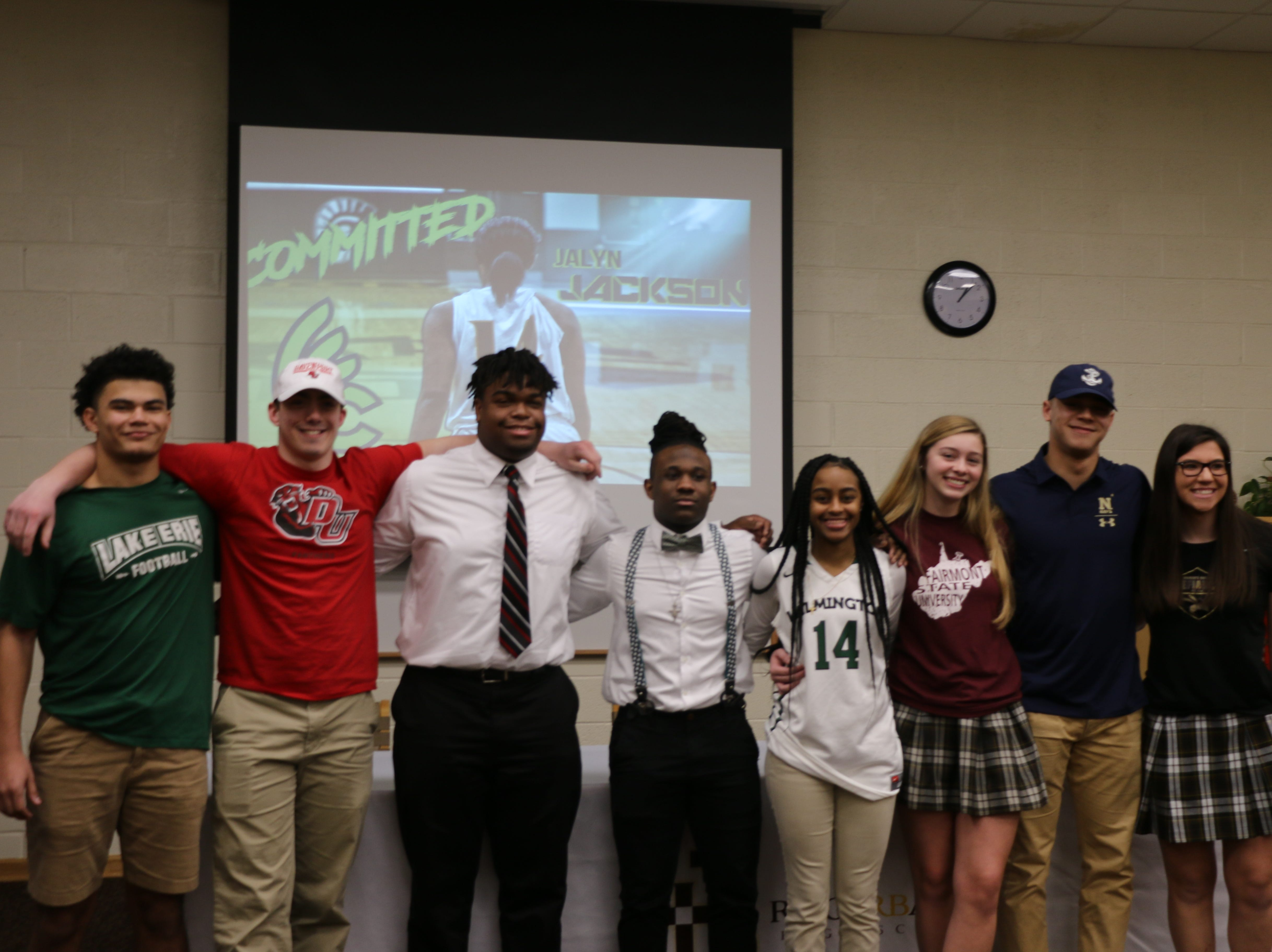Roger Bacon athletes signed their letters of intent to play college sports Feb. 6, 2019. They are, from left: Stan Hart (football, Lake Erie College), Zak Cappel (football, Davenport University), Dylan Polk (football, Walsh University), Brandon Tumlin (football, Wilmington College), Jalyn Jackson (basketball, Wilmington College), Anna Schulkers (soccer, Fairmont State), Zach Kuhlman (football, U.S. Naval Academy) and Ally Enneking (soccer, Defiance College).
