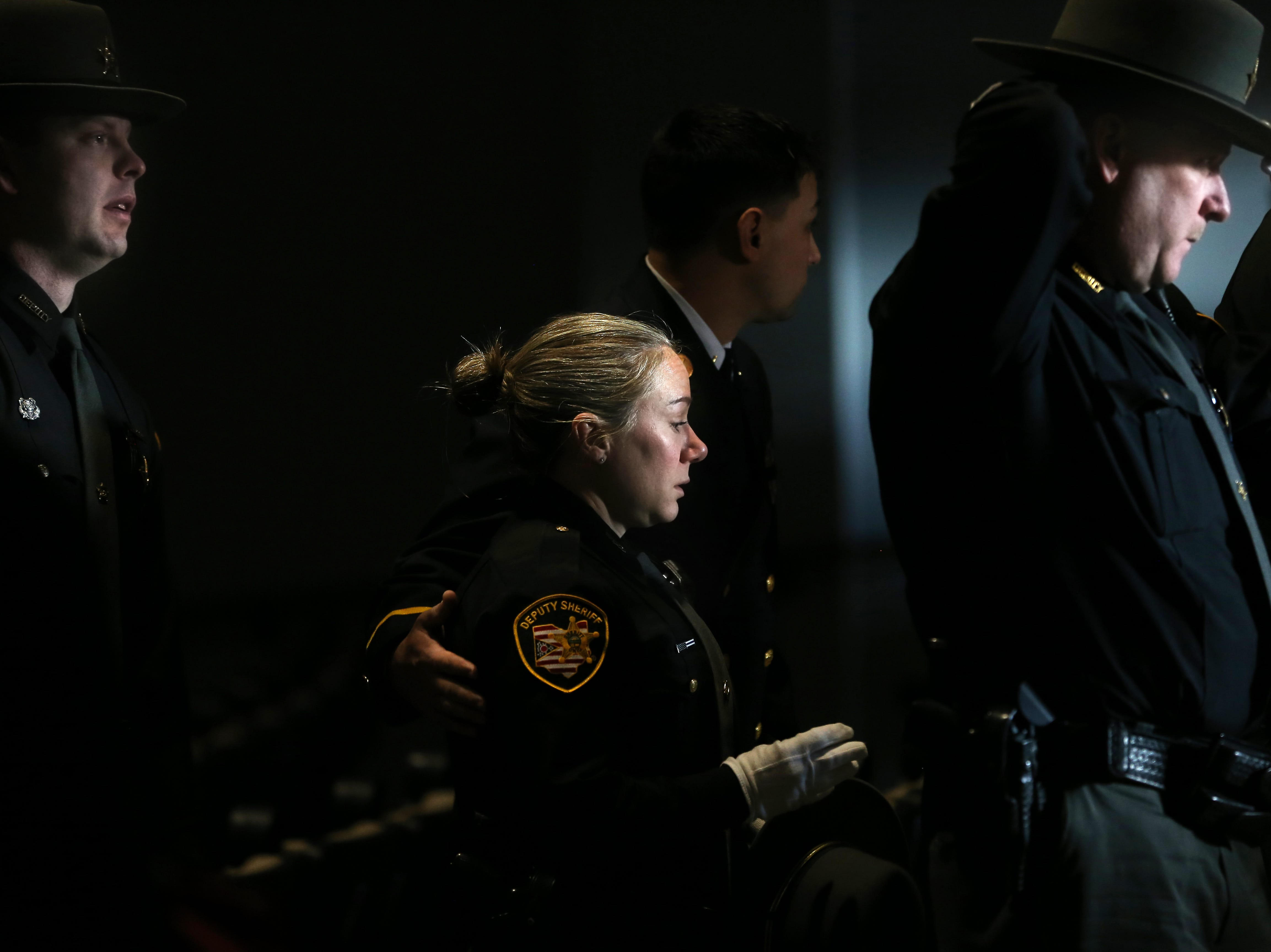 Mourners pay their respects during funeral services for Clermont County Sheriff's Detective William Lee Brewer Jr., Friday, Feb. 8, 2019, at Mount Carmel Christian Church in Union Township, Ohio. Brewer, a 20-year veteran of the Clermont County Sheriff's Office, died in the line of duty. He was shot Feb. 2 during a standoff. Brewer, 42, of Pierce Township, is survived by his wife, Jamie, and a 5-year-old son, Braxton. (Kareem Elgazzar/The Cincinnati Enquirer)