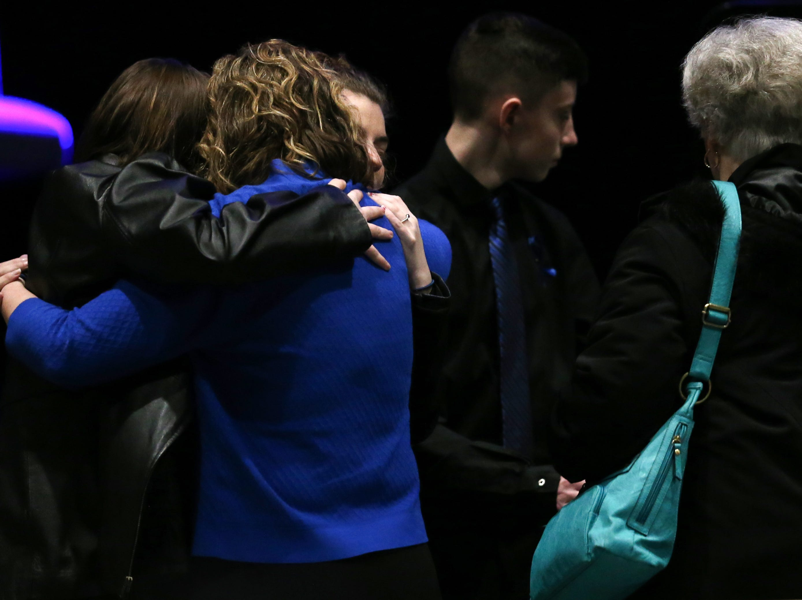 Jamie Brewer, widow of fallen Clermont County Sheriff's Detective William Lee Brewer Jr., is hugged during funeral services, Friday, Feb. 8, 2019, at Mount Carmel Christian Church in Union Township, Ohio. Brewer, a 20-year veteran of the Clermont County SheriffÕs Office, died in the line of duty. He was shot Feb. 2 during a standoff. Brewer, 42, of Pierce Township, is survived by his wife, Jamie, and a 5-year-old son, Braxton. (Kareem Elgazzar/The Cincinnati Enquirer)