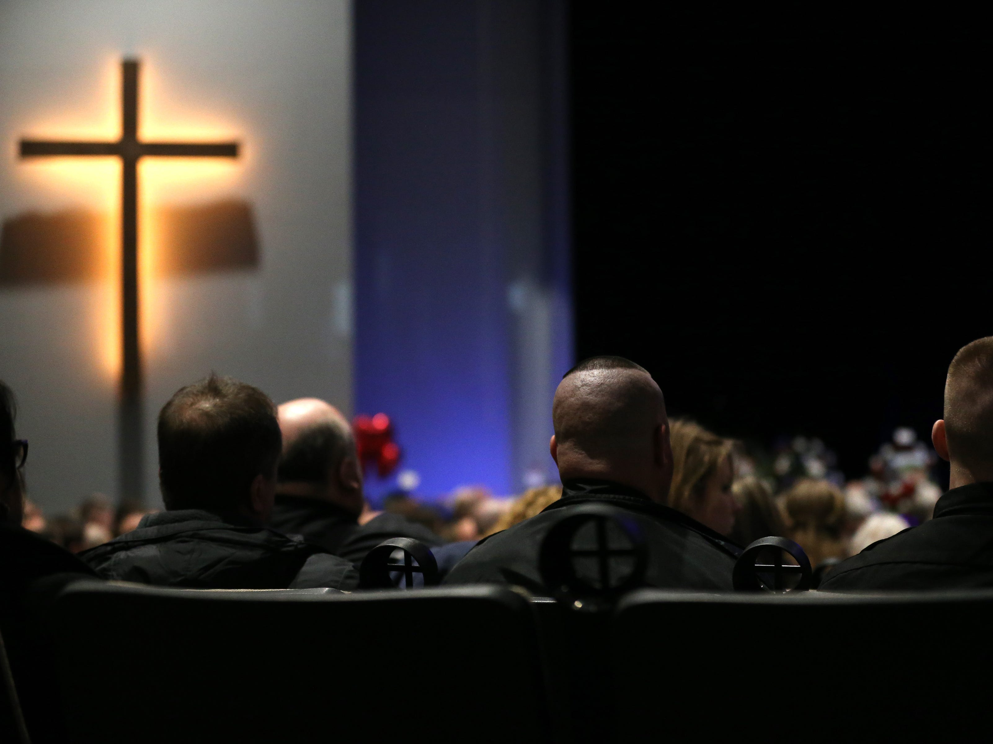 People pay their respects during funeral services for Clermont County Sheriff's Detective William Lee Brewer Jr., Friday, Feb. 8, 2019, at Mount Carmel Christian Church in Union Township, Ohio. Brewer, a 20-year veteran of the Clermont County Sheriff's Office, died in the line of duty. He was shot Feb. 2 during a standoff.
