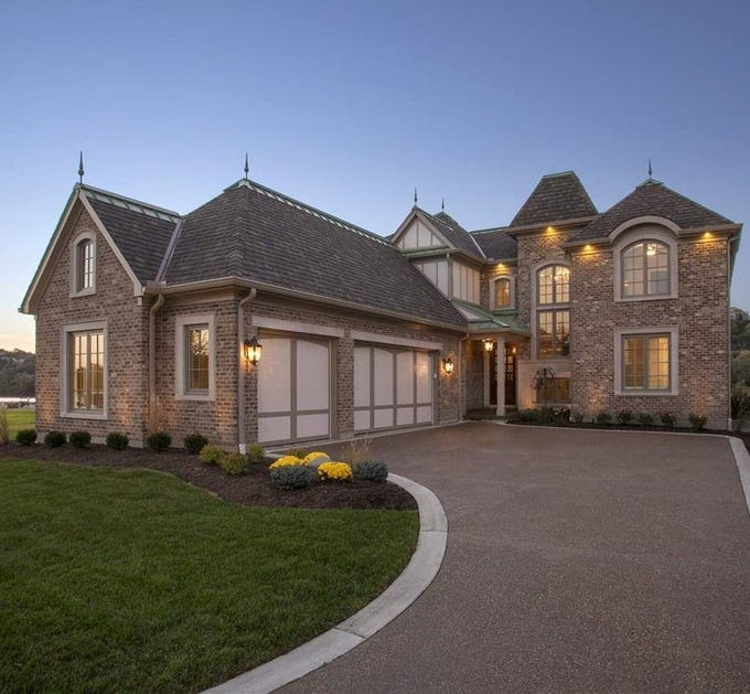 This custom-built home sits 100 feet from the Ohio River in the Manhattan Harbour development in Bellevue, Ky.