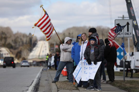 The community showed up Friday to support the Clermont County Sheriff's Office and the family of Deputy Bill Brewer, who was killed in a standoff over the weekend. A procession followed the funeral service.