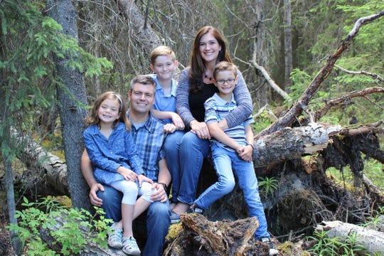 Gayleen Gavitt (second from right), her husband Brian, and their children.