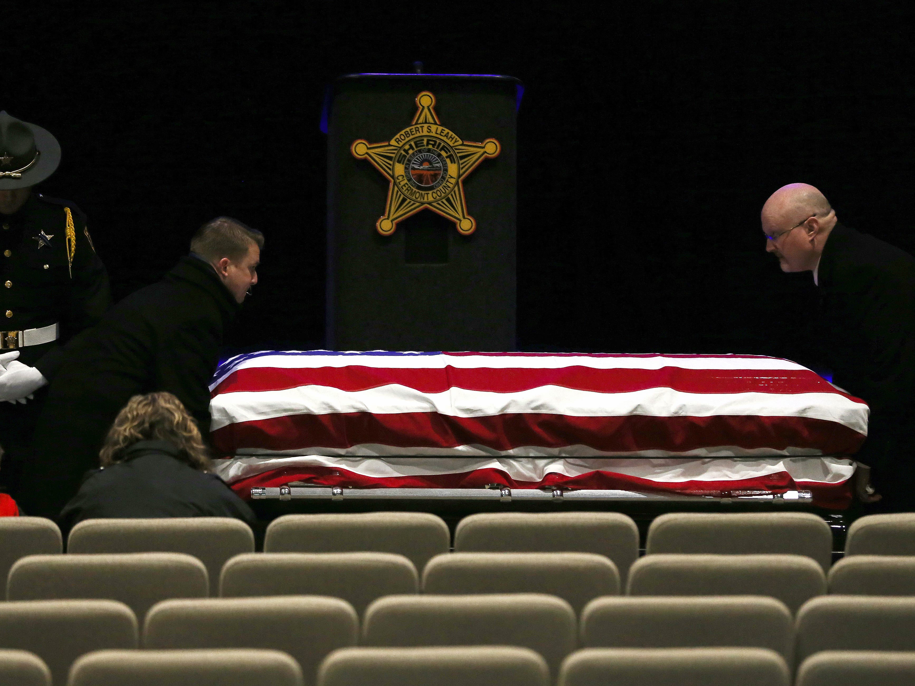 The casket of Clermont County Sheriff's Detective William Lee Brewer Jr. is placed as his son, Braxton, 5, and wife, Jamie, sit in attendance ahead of funeral services, Friday, Feb. 8, 2019, at Mount Carmel Christian Church in Union Township, Ohio. Brewer, a 20-year veteran of the Clermont County Sheriff's Office, died in the line of duty. He was shot Feb. 2 during a standoff. Brewer, 42, of Pierce Township, is survived by his wife, Jamie, and a 5-year-old son, Braxton. (Kareem Elgazzar/The Cincinnati Enquirer)