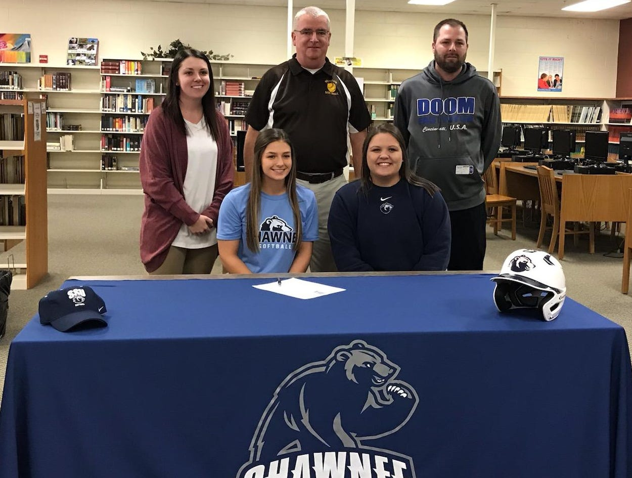 Andrea Little, catcher from Western Brown High School, signed to play softball at Shawnee State University Feb. 6. With her is, from left: top, Jamie Hurley, Western Brown assistant coach; Blaine Wallace, Western Brown head coach; Jason Barnes, Cincy Doom travel ball coach; and bottom Ashly Webb, Shawnee State assistant coach.