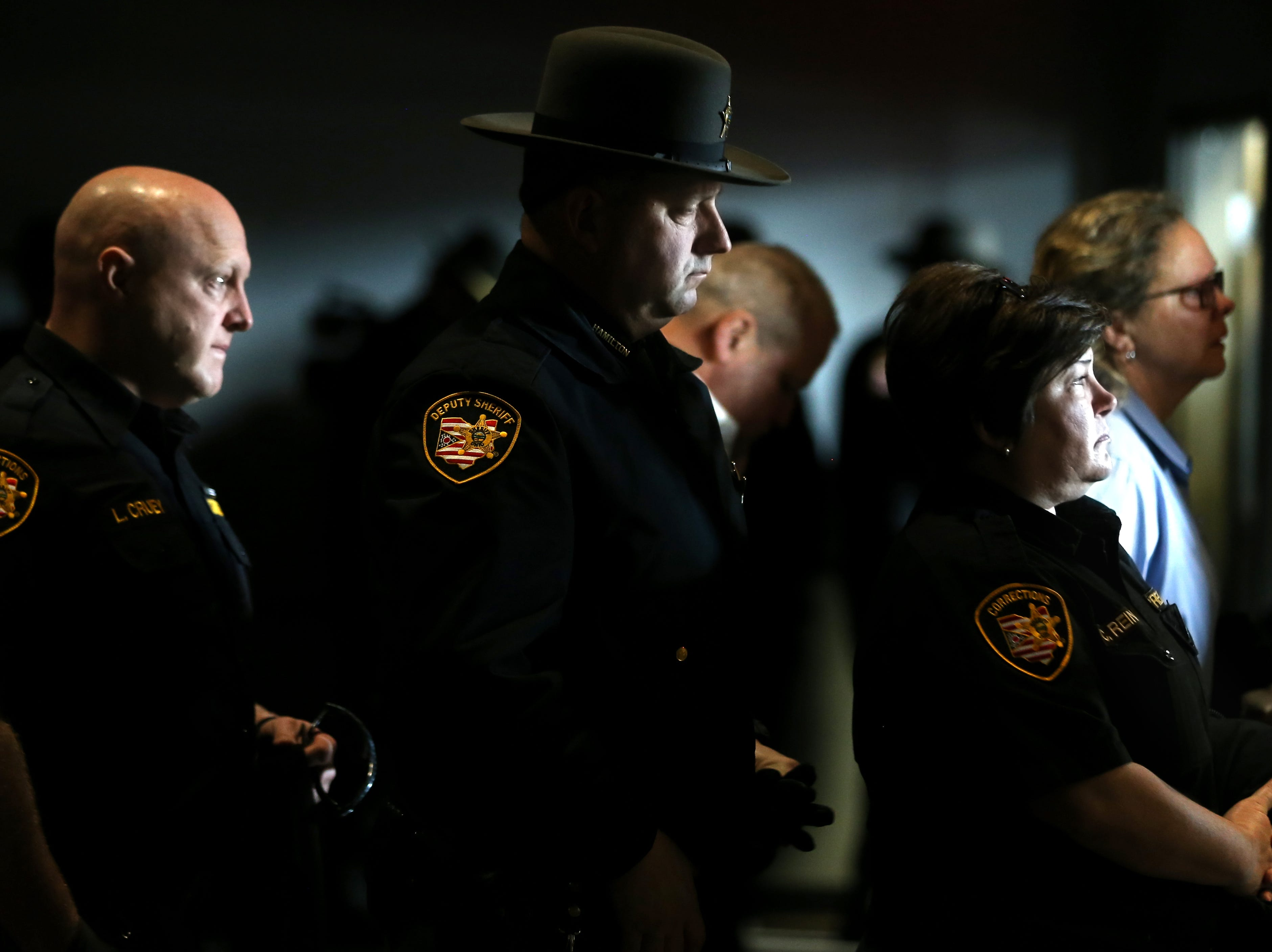 Mourners exit at the conclusion of funeral services for Clermont County Sheriff's Detective William Lee Brewer Jr., Friday, Feb. 8, 2019, at Mount Carmel Christian Church in Union Township, Ohio. Brewer, a 20-year veteran of the Clermont County Sheriff's Office, died in the line of duty. He was shot Feb. 2 during a standoff. Brewer, 42, of Pierce Township, is survived by his wife, Jamie, and a 5-year-old son, Braxton. (Kareem Elgazzar/The Cincinnati Enquirer)