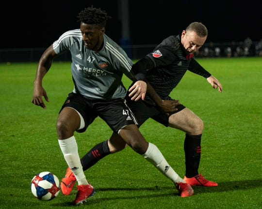 FC Cincinnati defender Hassan Ndam (47) and D.C. United forward Wayne Rooney (9)  fight for the ball during the second half at IMG Academy.