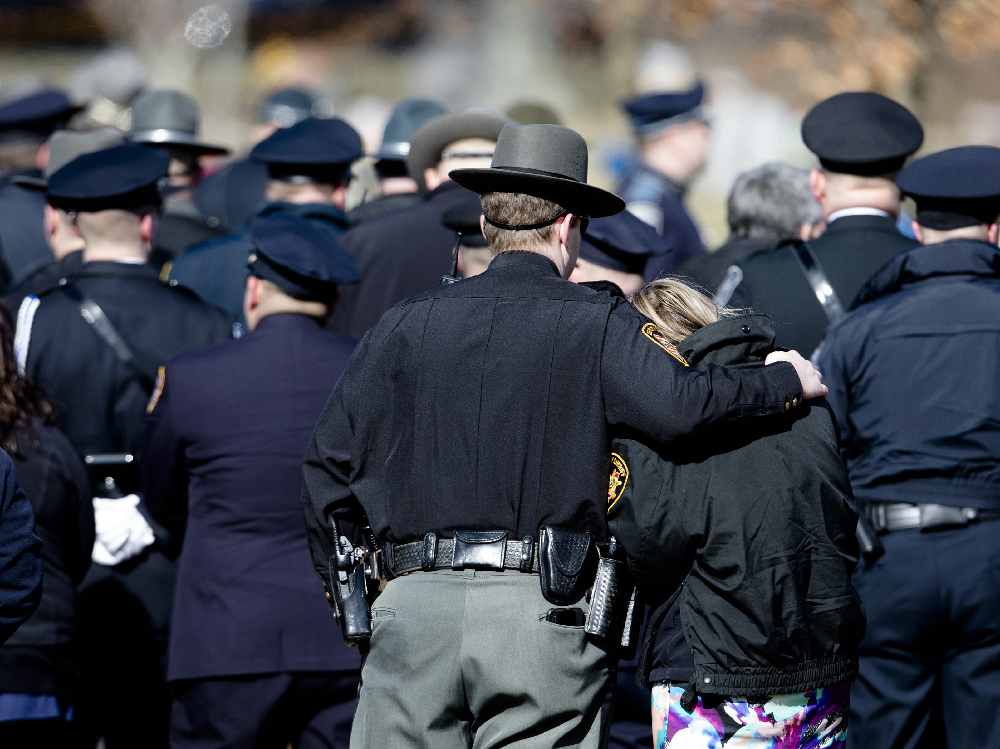 Family, friends and law enforcement arrive for the burial service of Detective Bill Brewer, a 20-year veteran of the Clermont County Sheriff's Office, on Friday, Feb. 8, 2019, at Pierce Township Cemetery in Cincinnati. Brewer, 42, of Pierce Township, died in the line of duty. He was shot Feb. 2 during a standoff. Deputy Brewer is survived by a wife and 5-year-old son.